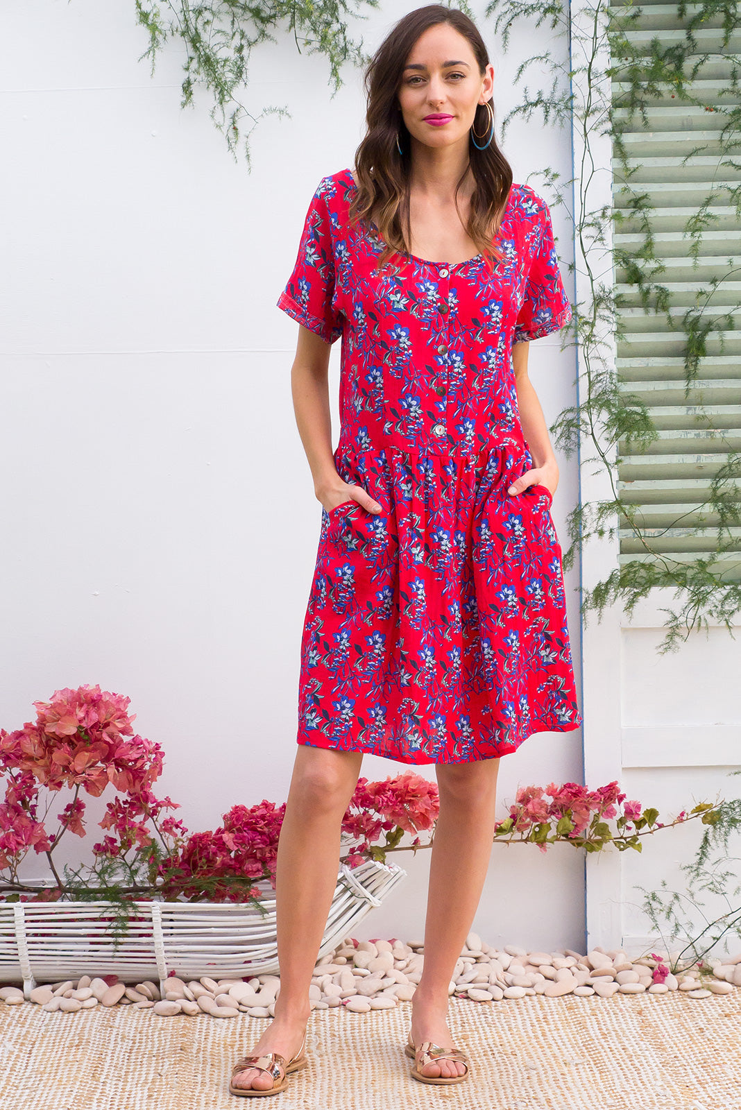 Rosella Rosetti Real Red dress features a button front to the drop waist and 2 front pockets in a gorgeous bright red floral bohemian print  print on a cotton polyester blend fabric