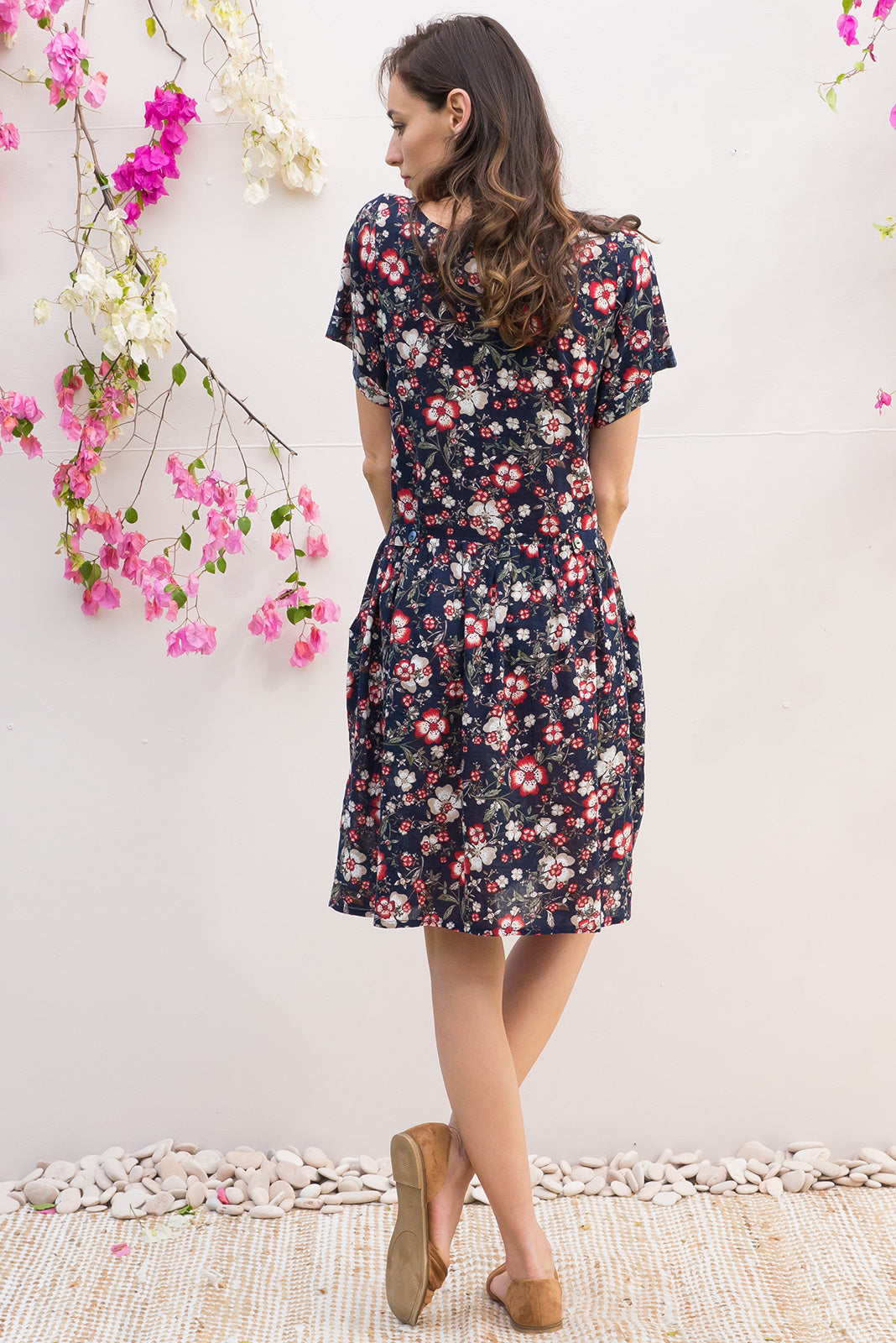 Rosella Rustic Navy Cotton dress features a button front to the drop waist and 2 front pockets in a bohemian floral navy print on a cotton rayon blend fabric