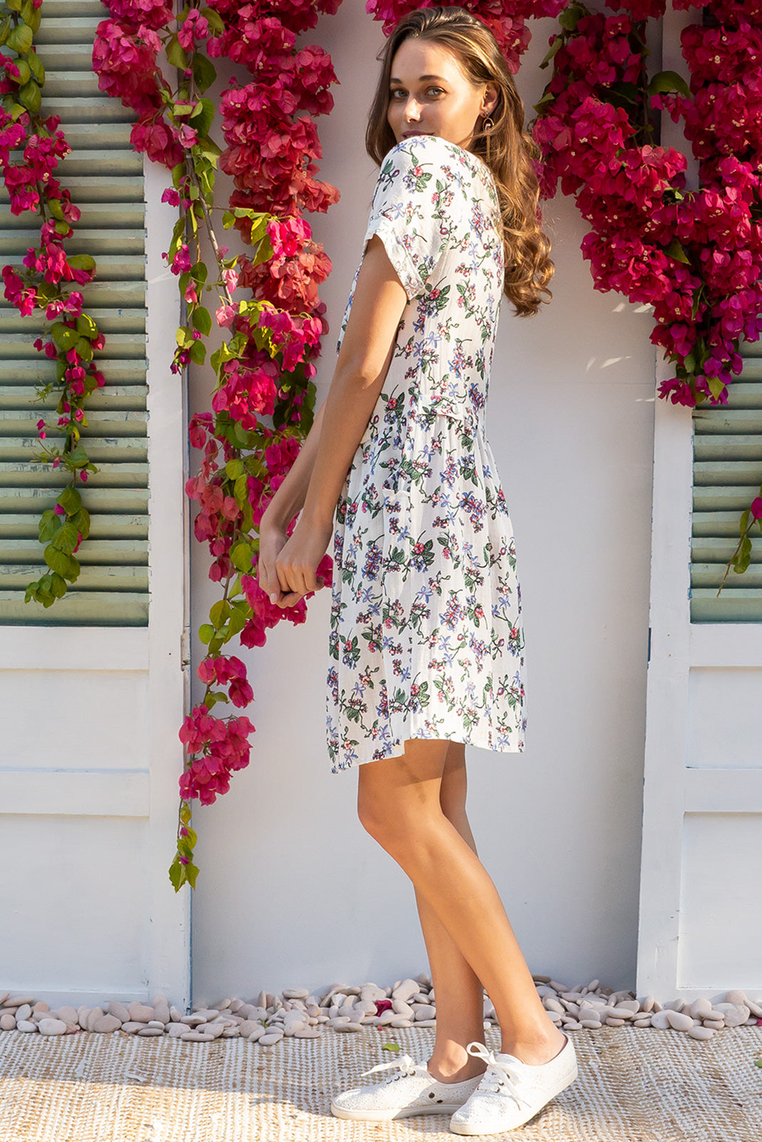 Rosella Windsor White dress features a button front to the drop waist and 2 front pockets in a delicate bohemian floral white based print on a rayon polyester blend fabric
