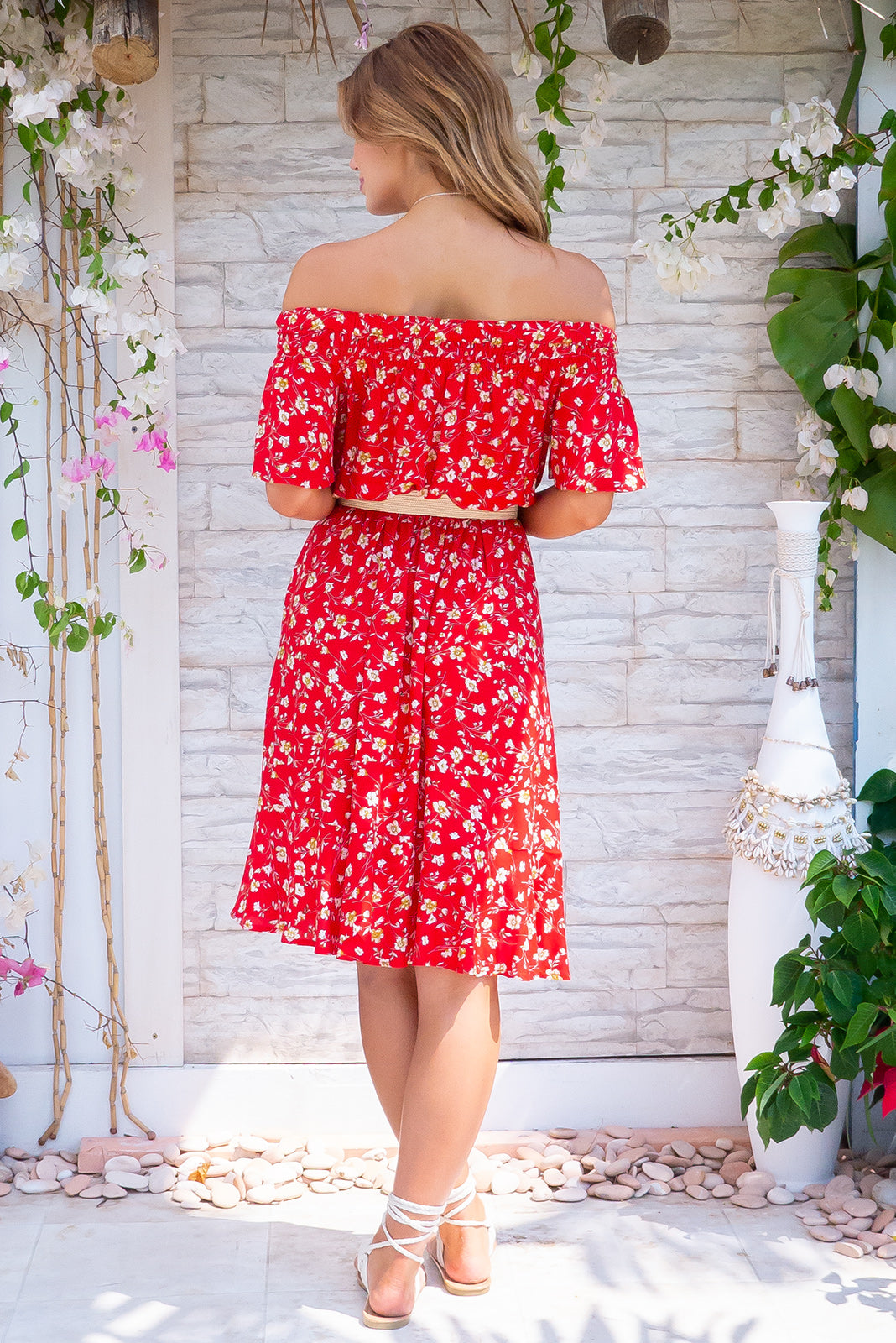 Roxie Tangelo Red Mini Dress, a red hot summer number has soft elastic and ruching to gently hold the dress across the shoulders, side pockets, elastic waist in bright red base with a delicate ditzy floral design in woven 100% viscose.