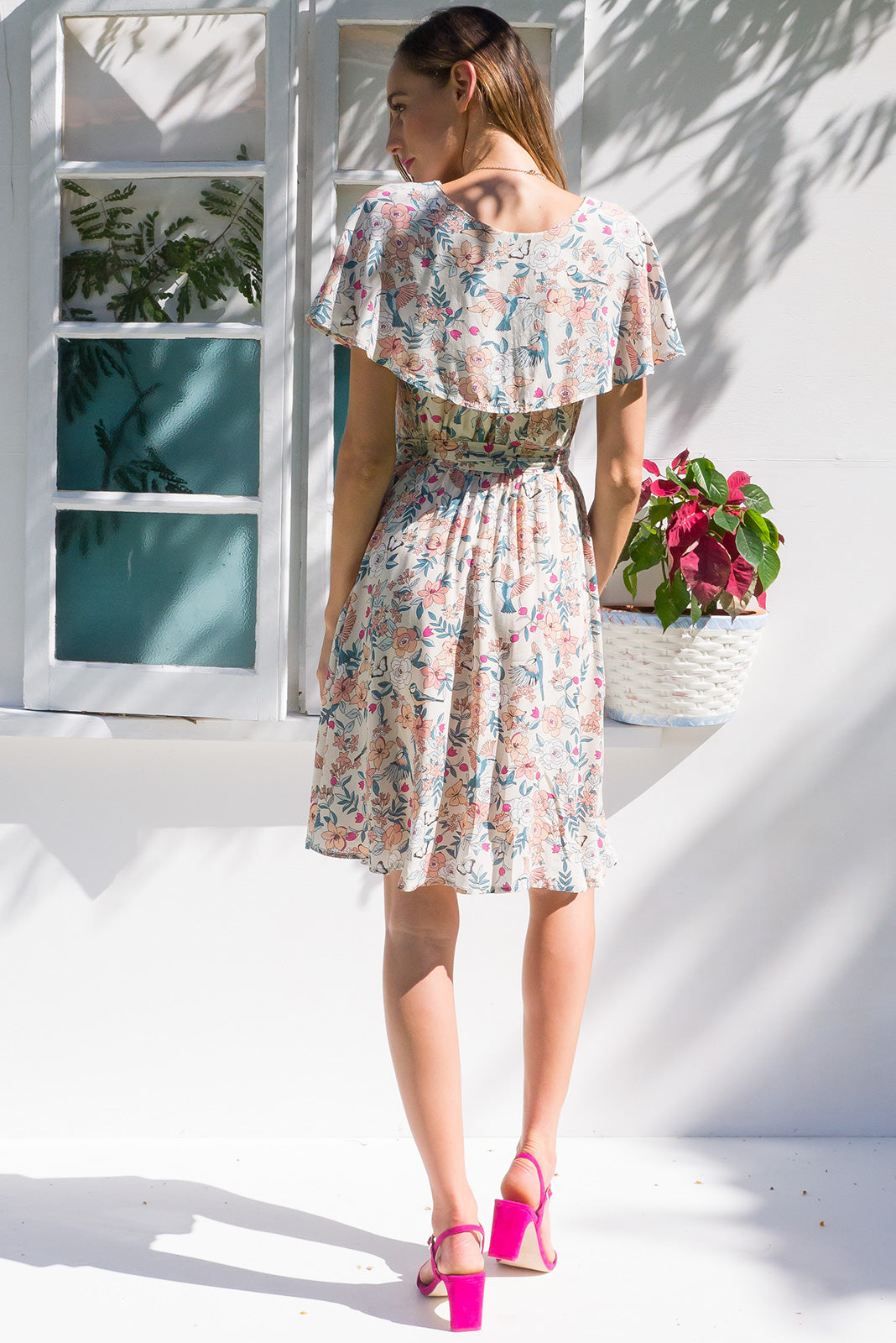 Rita Rio Feathers Cream Wrap Dress with a full frill around the neck and sleeve in a cream and pink bird print on rayon