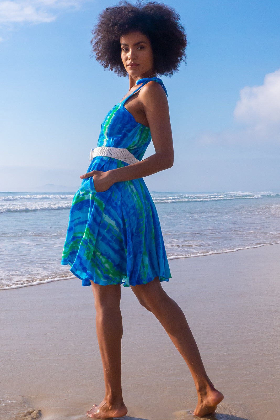 The coolest blue tie dye dress, the Ruby Tuesday Bolo Blue Dress features 100% viscose, straight neckline, tie up shoulder straps, button front and it comes with white woven belt.