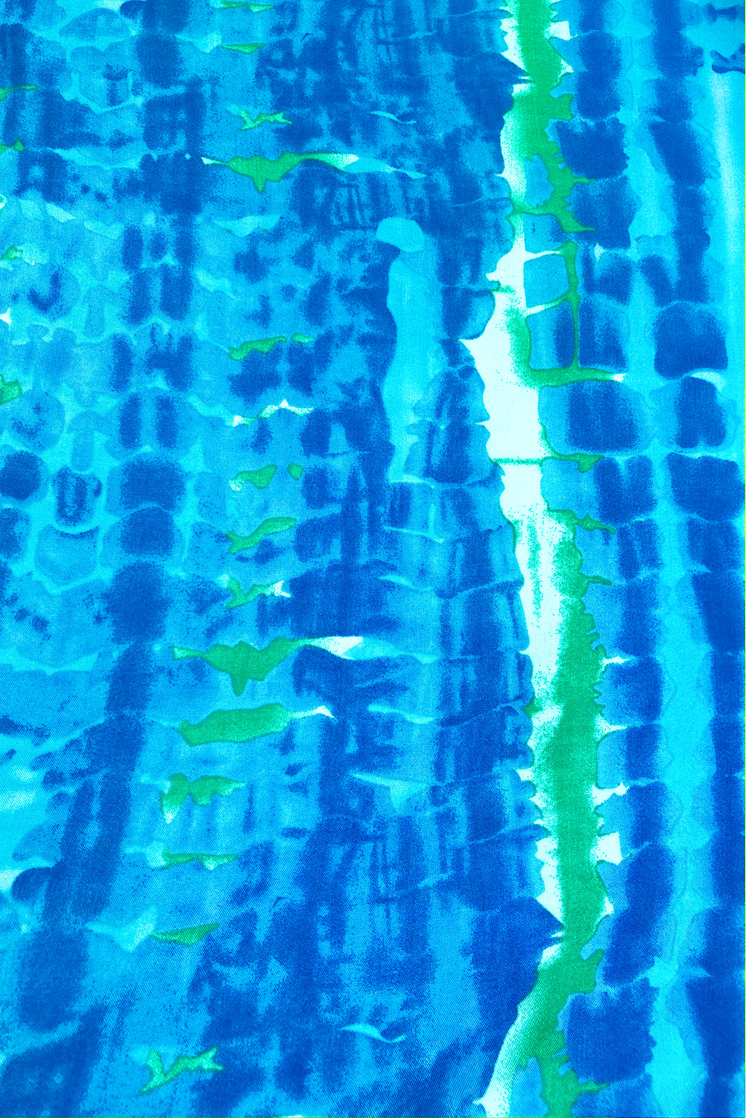 Fabric Swatch o f Ruby Tuesday Bolo Blue Dress featuring  100% rayon in blue and green tie dye print.