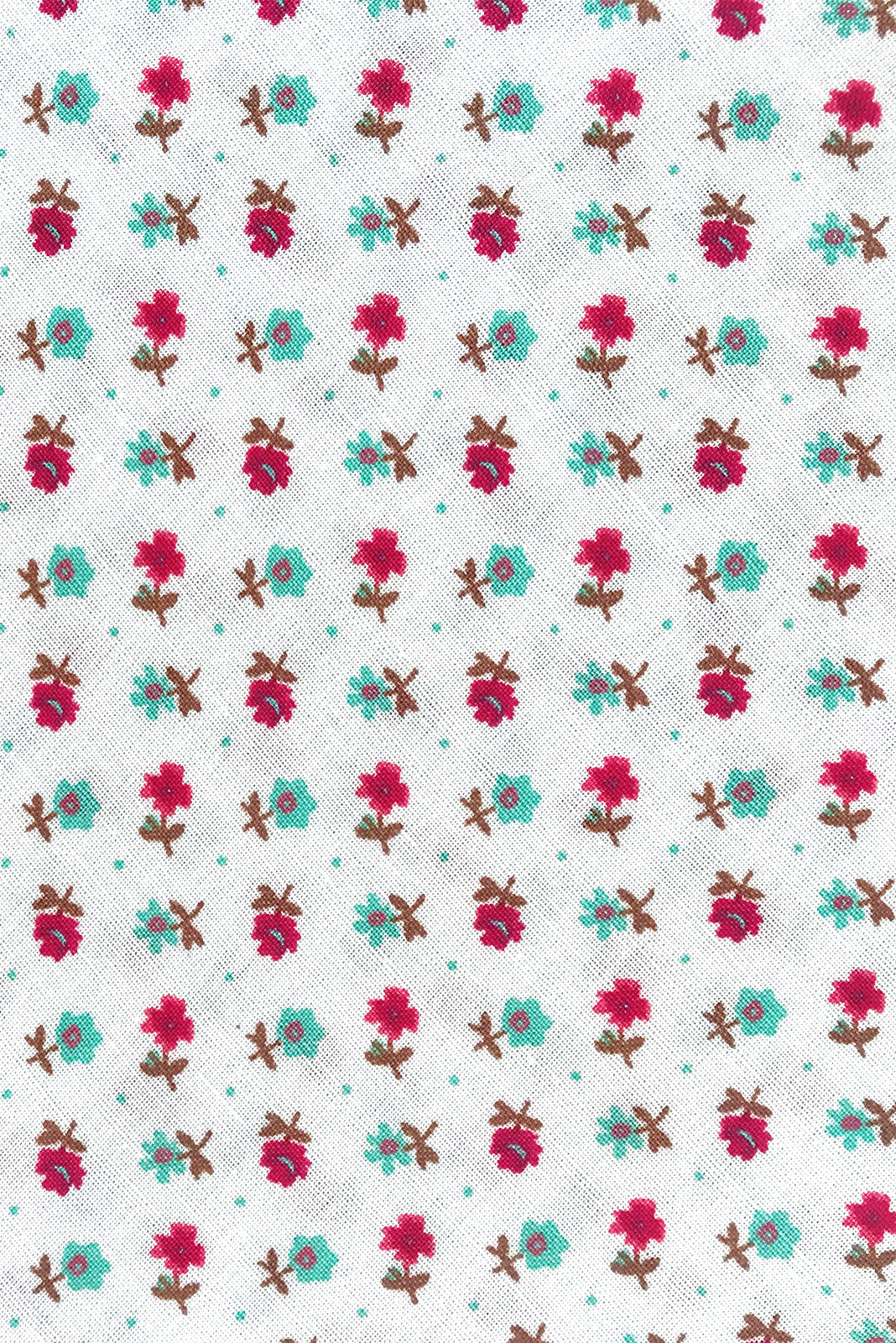 Fabric swatch of Ruby Tuesday Dotty White Dress featuring 100% viscose in white base with small blue and red floral print.