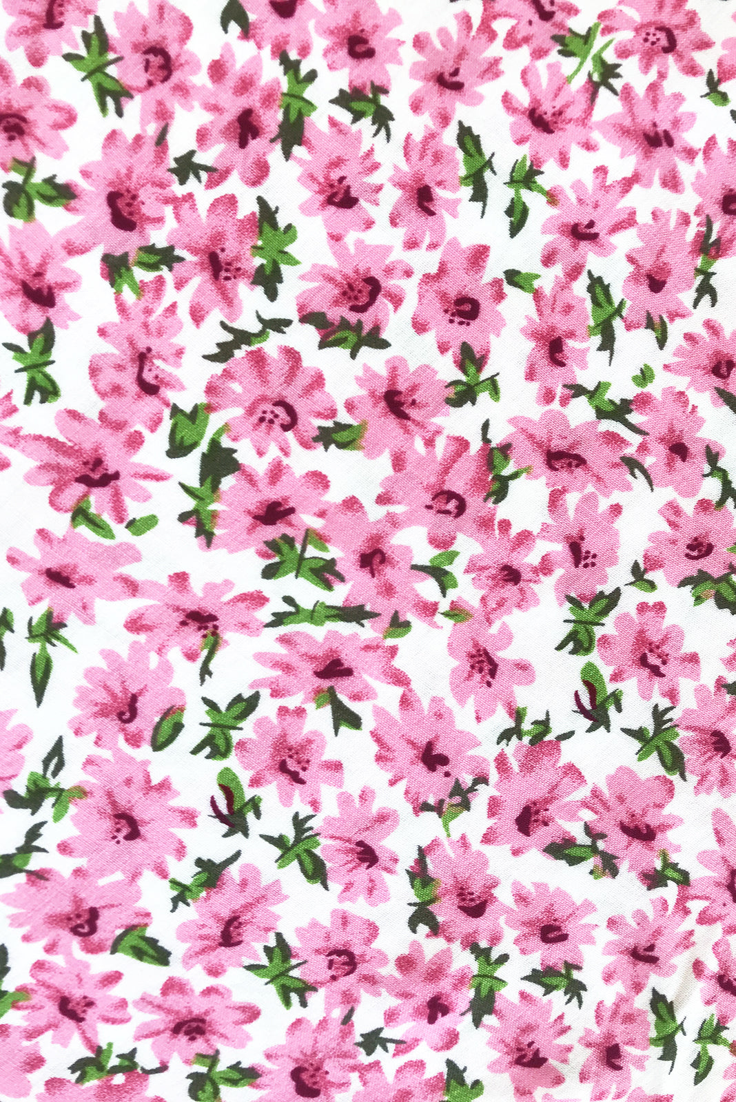 Fabric Swatch of Ruby Tuesday Fresh Pink Dress featuring 100% viscose in white base with pink flower print.