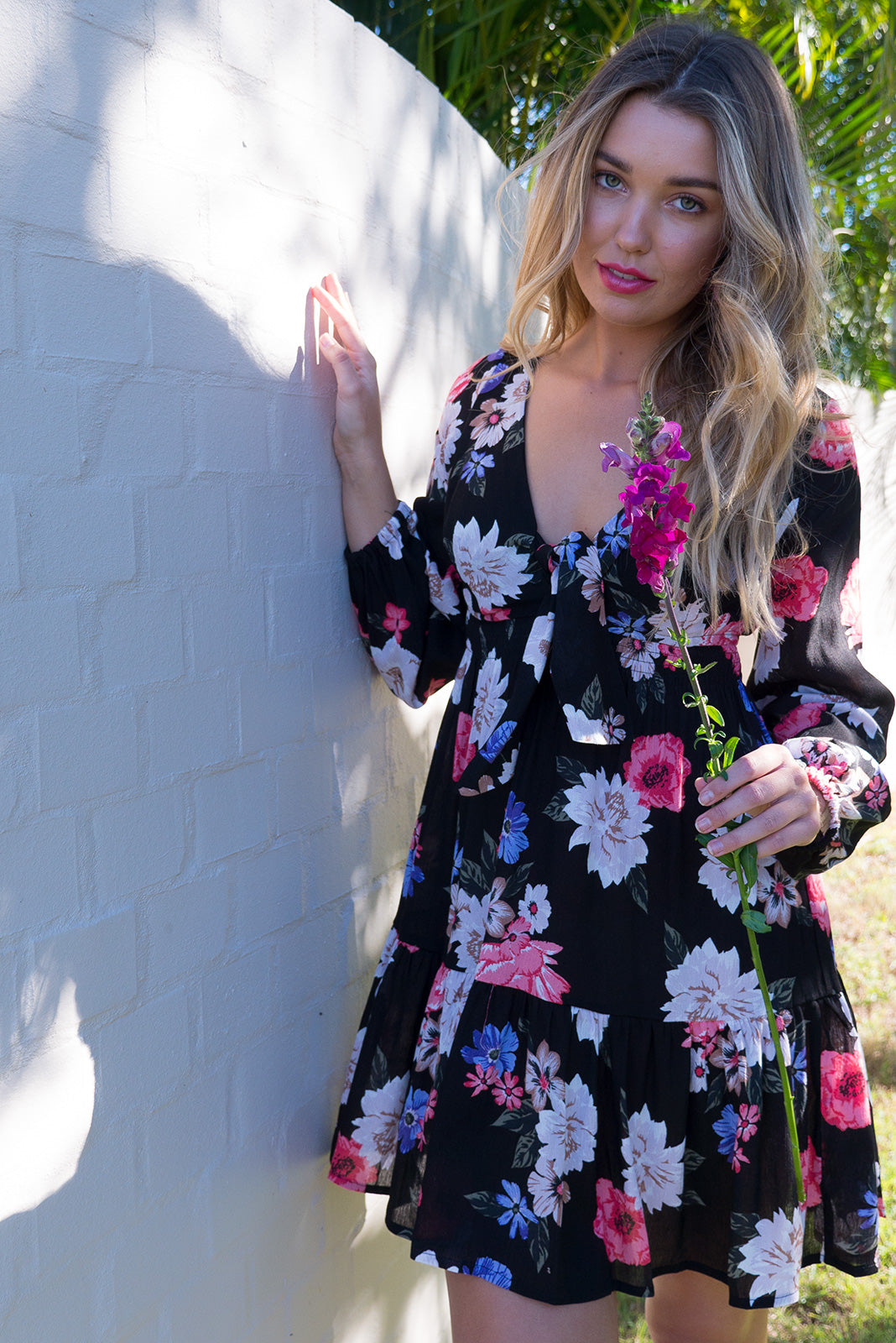 Ruby Floral Noir dark bright vintage boho inspired empire line elasticated waist dress with a adjustable tie front and tiered skirt in a soft crinkle textured dark bright black based floral print