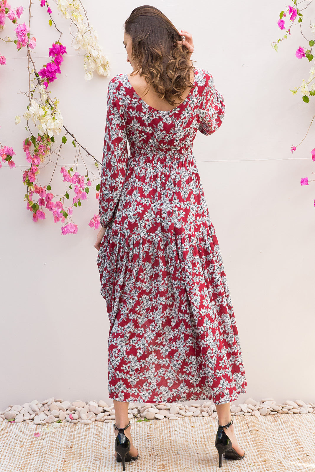 Ruby Red Currant Dress with an empire line elasticated waist dress with a adjustable tie front and tiered skirt in a soft crinkle textured dark red and white small floral print