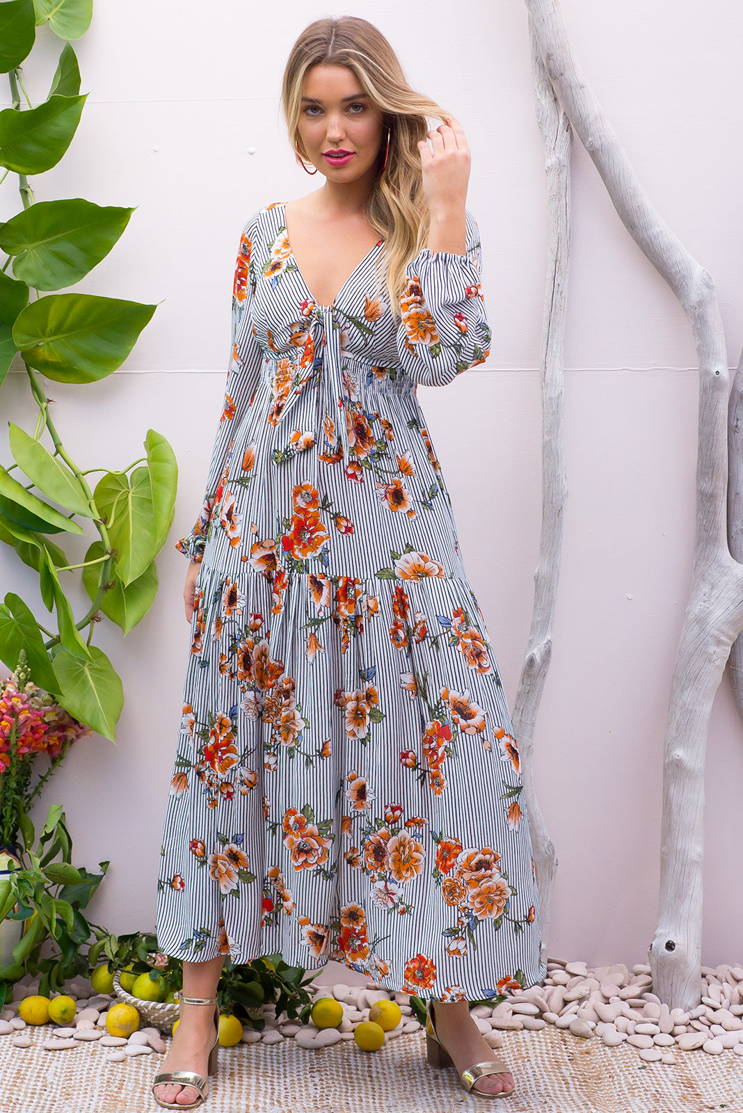 Ruby Stripes and floral Maxi Dress with an empire line elasticated waist dress with a adjustable tie front and tiered skirt in a soft crinkle textured pin stripe and floral print
