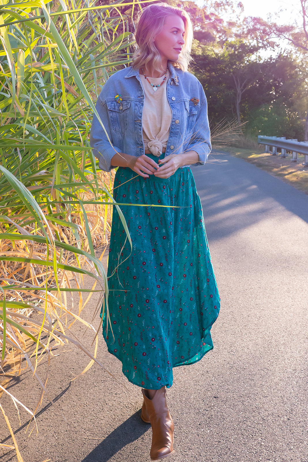 Sails Emerald Garden Maxi Skirt, a perfect boho look, features scooped hemline shorter at sides, V-shaped panelled waist band, shirred back waist, functional side pockets, woven 100% cotton in Blue/green base with simple floral pattern.