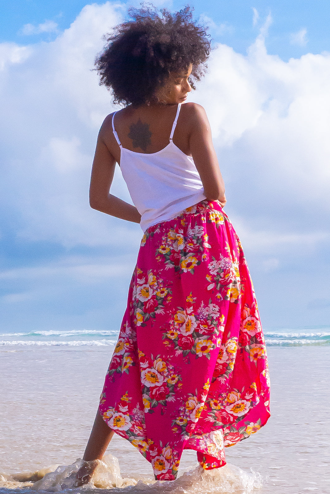 The Sails Fuchsia Culebra Cotton Maxi Skirt has scooped hemline, shorter at sides, V-shaped panelled waist band, elasticated back of waist, side pockets and it's 65% cotton, 35% rayon in bold fuchsia pink base with large summer floral print.