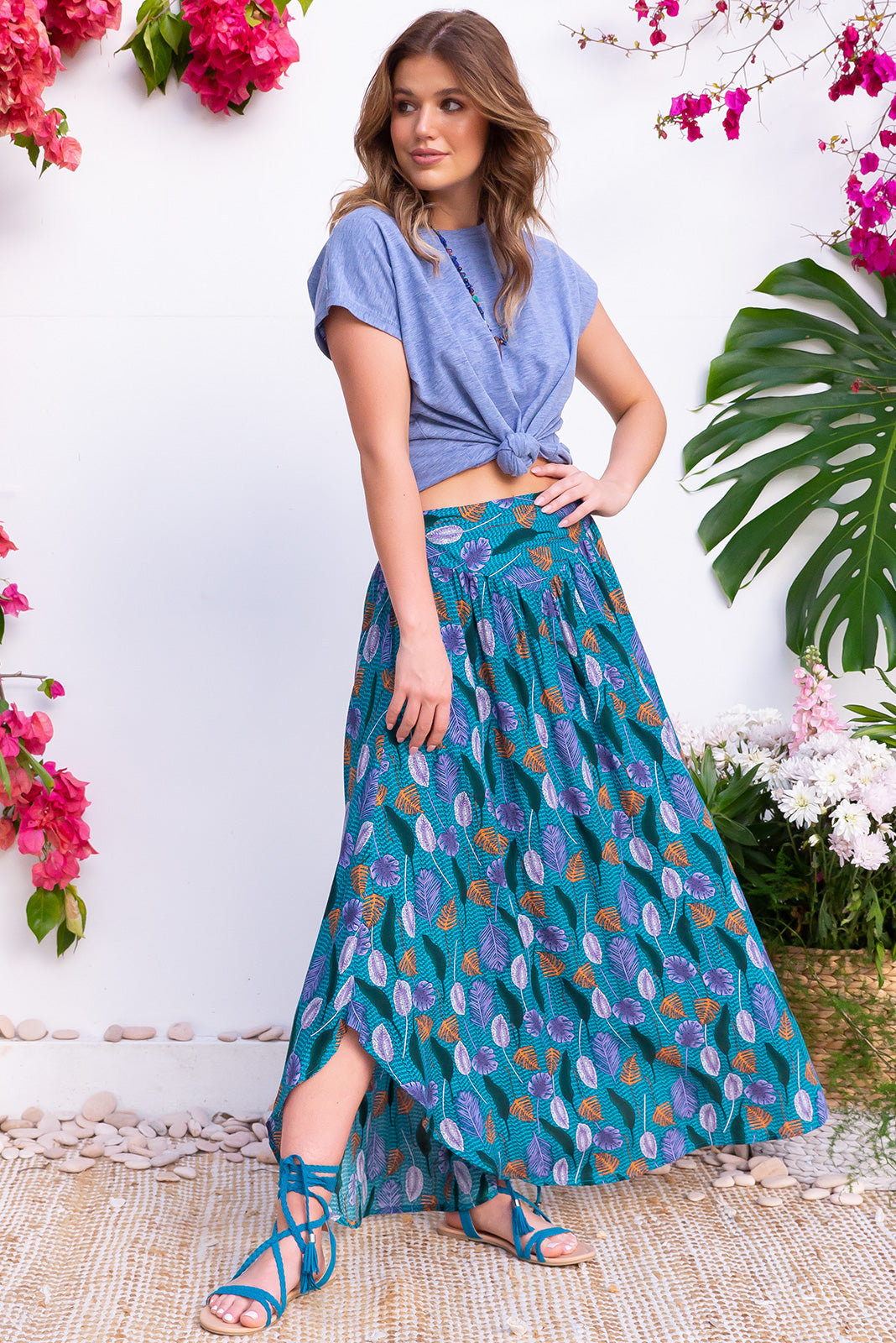 Sails Capilano Teal Maxi Skirt is a scooped hem and flowy maxi length bohemian skirt. With a multicoloured leaf pattern on a teal base. Very tropical and fresh for Spring. 100% Viscose.