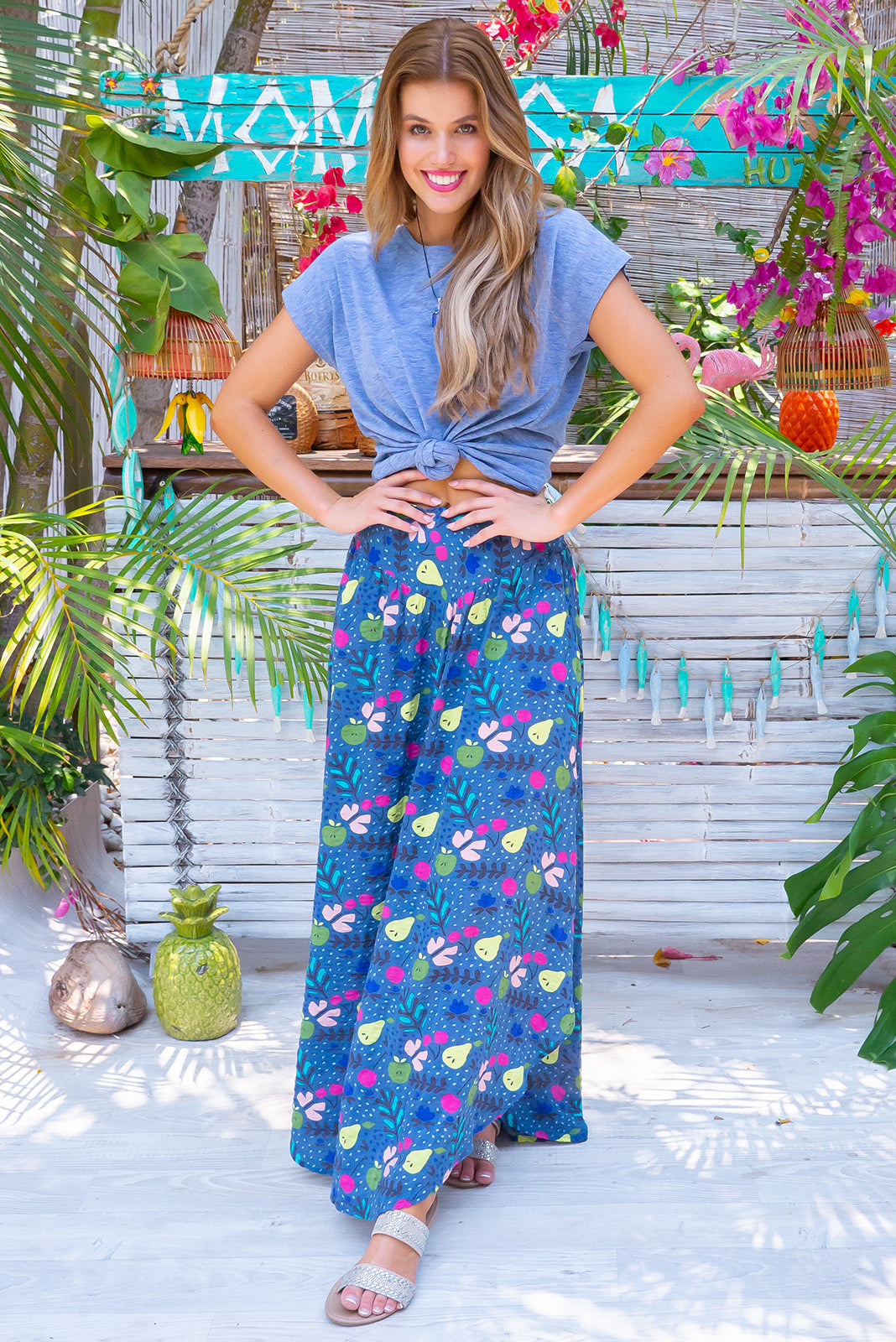 Sails Fruity Navy Maxi Skirt, bohemian summers style, 100% cotton with seersucker texture, scooped hemline shorter at sides, v shaped panelled waist band, elasticated back of waist, side pockets, navy base with medium lime green, fuchsia, blue and pastel pink fruit print.