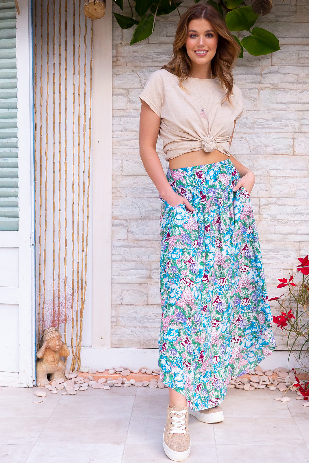 Sails Summer Vine Maxi Skirt features a stunning, fresh colourful floral and grape print on 100% viscose fabric. Soft flowing maxi length with side pockets and an elastic back waist band.