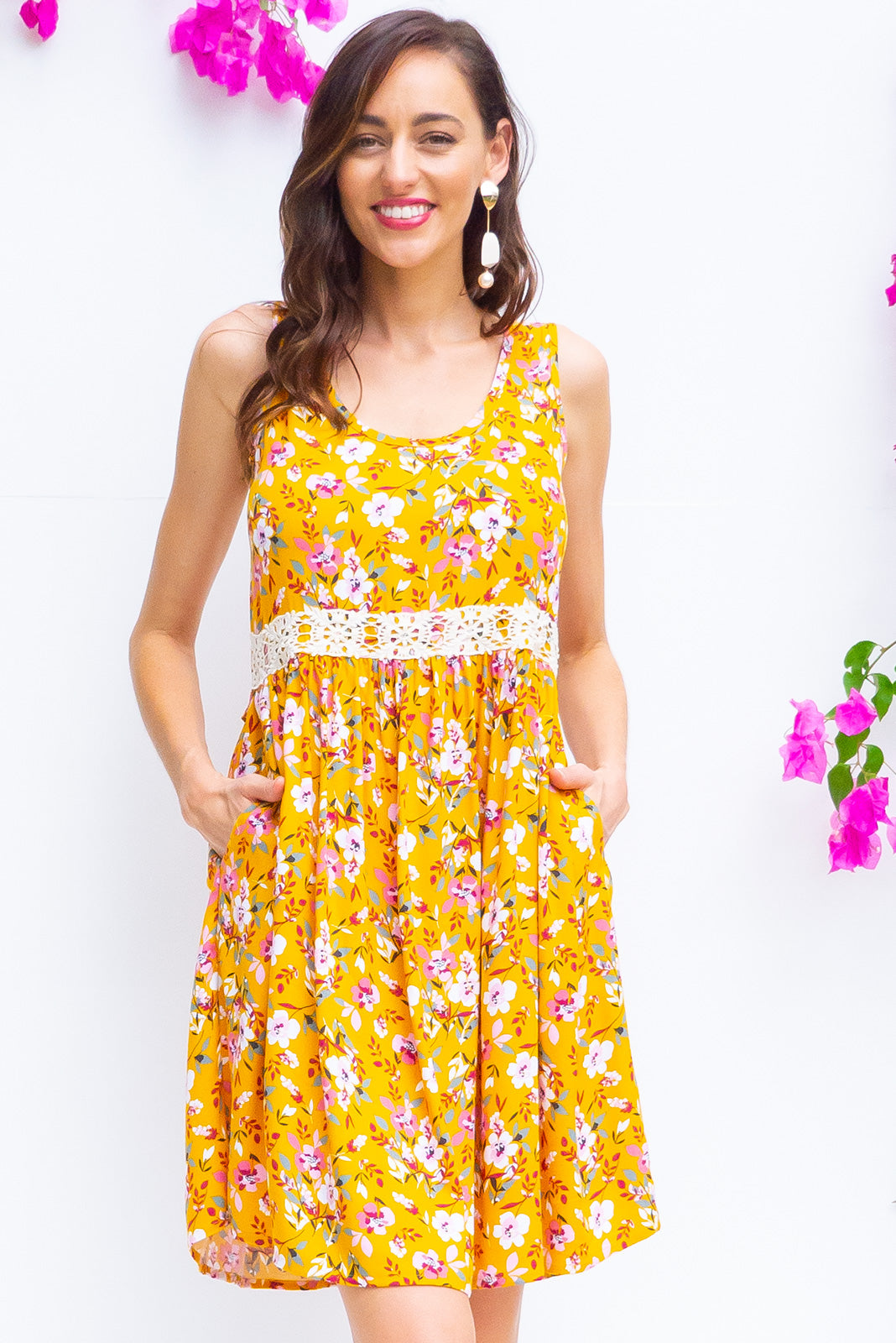 Sandi Starburst Gold Dress is a soft cut sleeveless dress with a adjustable button tab with feature cotton lace in a bold gold floral print on a crepe textured woven rayon