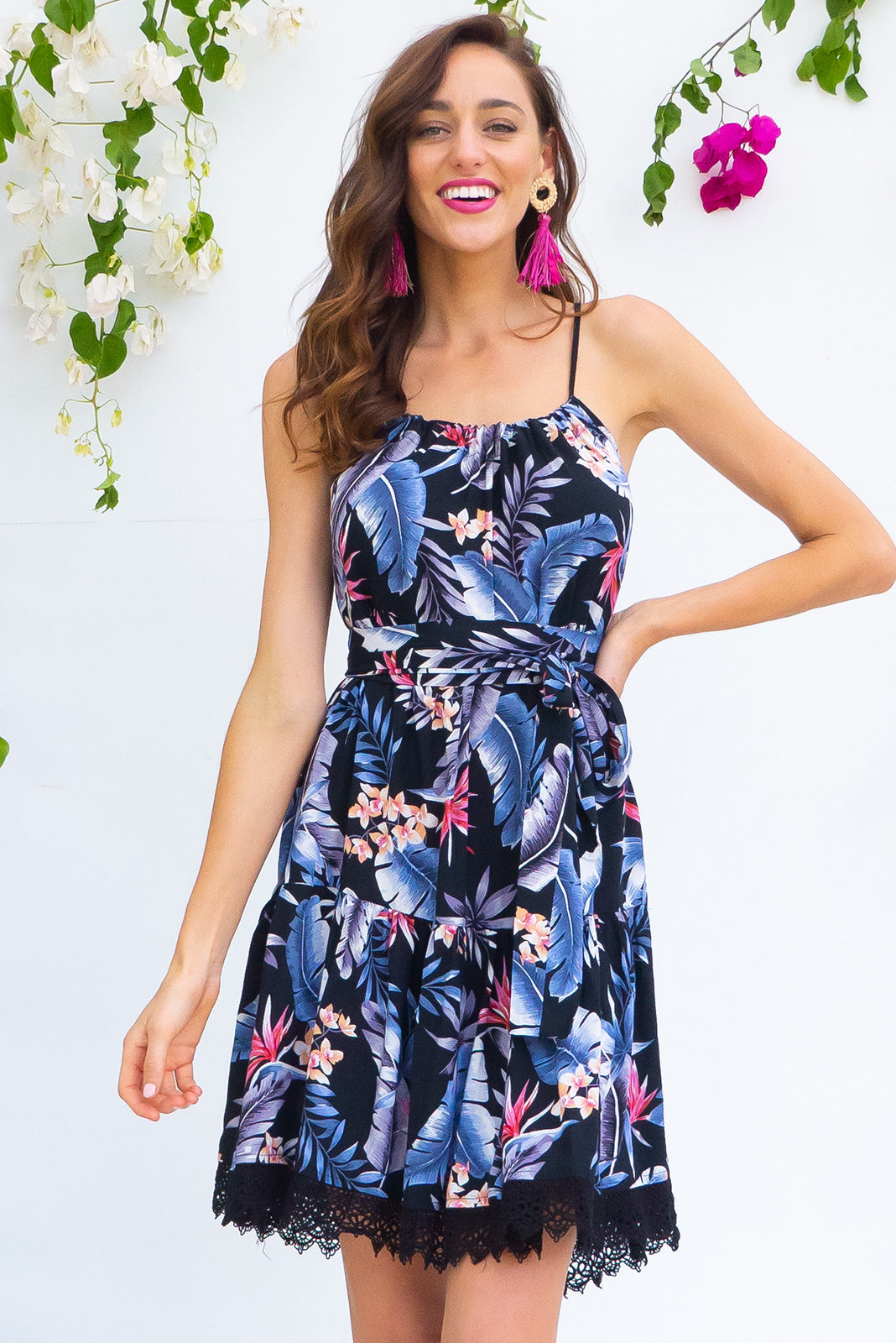 Santorini Inky Jungle tiered dress with an adjustable rope neckline, deep side pockets and cotton lace detailing in a deep inky navy blue based tropical print on 100% rayon