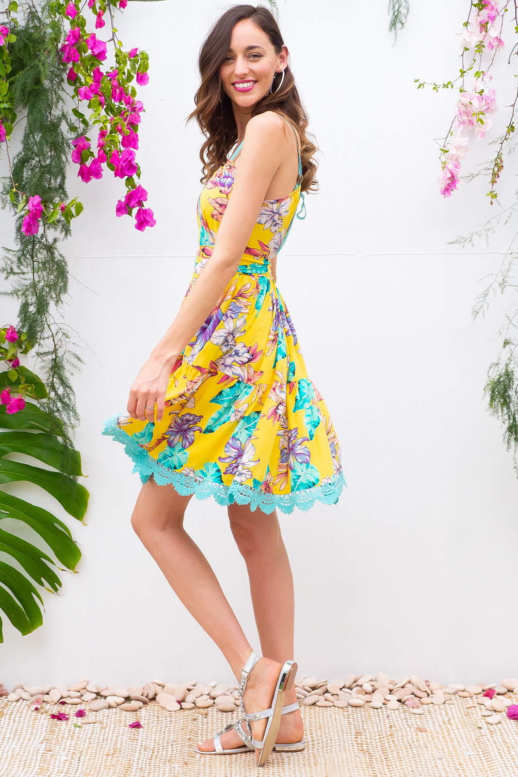 Santorini Pineapple Punch tiered dress with an adjustable rope neckline, deep side pockets and cotton lace detailing in bright yellow tropical print on 100% cotton