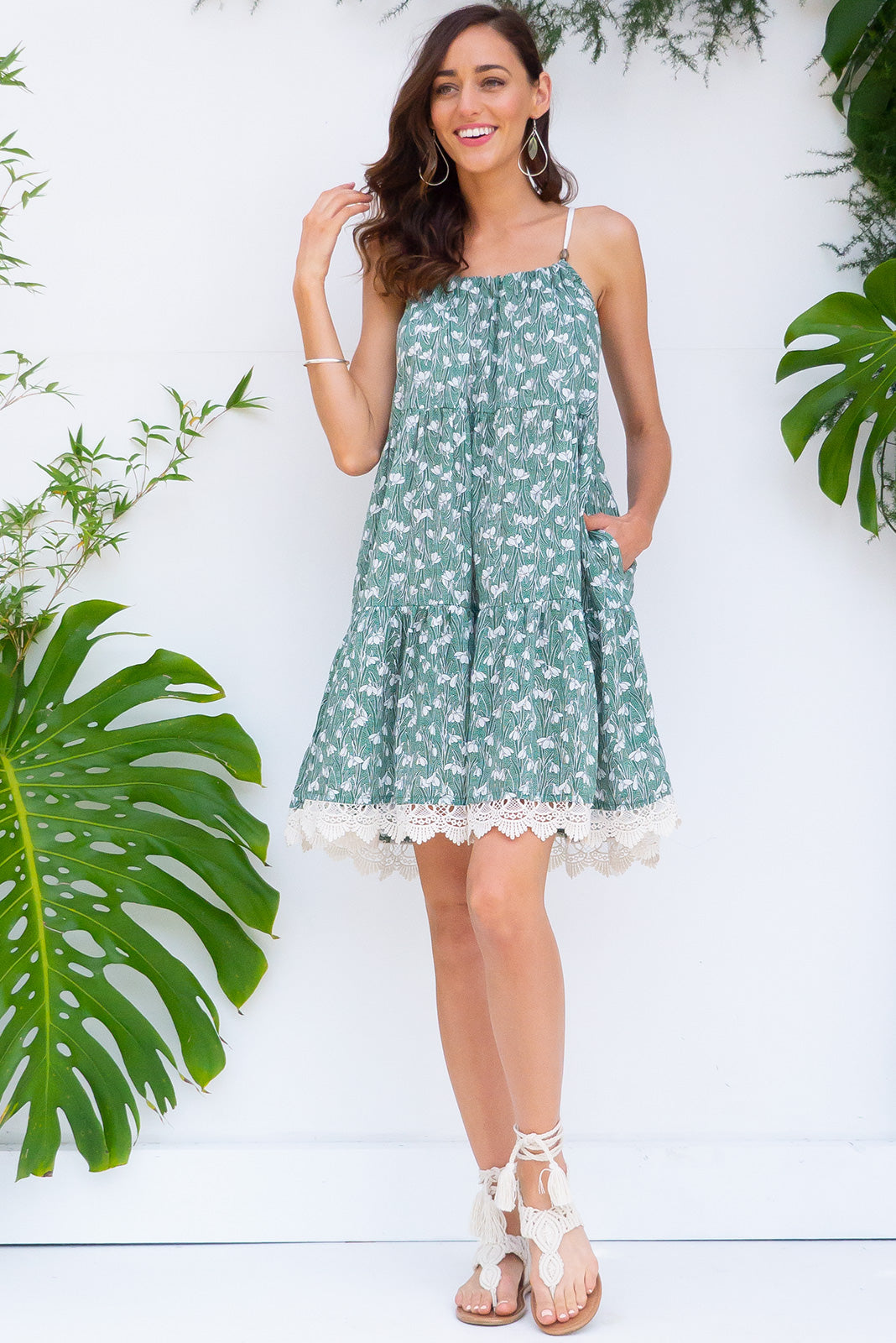 Santorini Sage Green tiered dress with an adjustable rope neckline, deep side pockets and cotton lace detailing in soft sage green snowdrop floral  print on 100% cotton