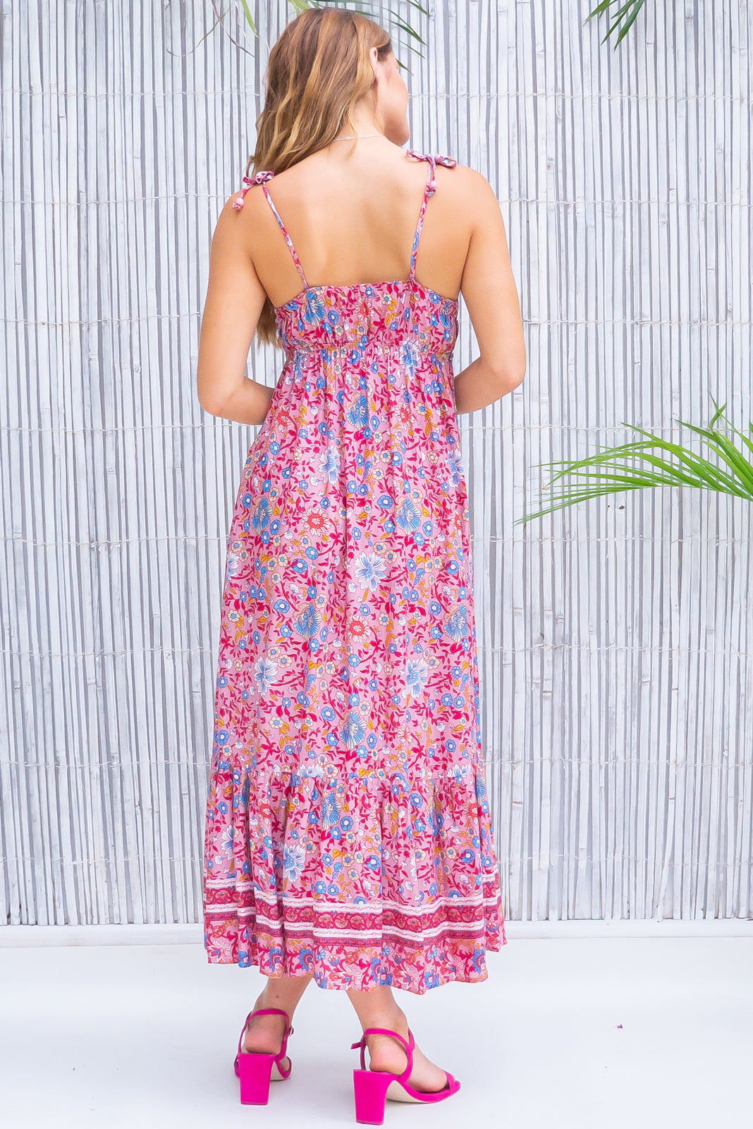 Sapphire Raspberry Maxi Dress, pretty pink dress features elasticated under bust, empire line, sleeveless with adjustable tie up straps, print placement will vary, side pockets, soft pink base with raspberry, blue, white and yellow floral print in woven 100% rayon.