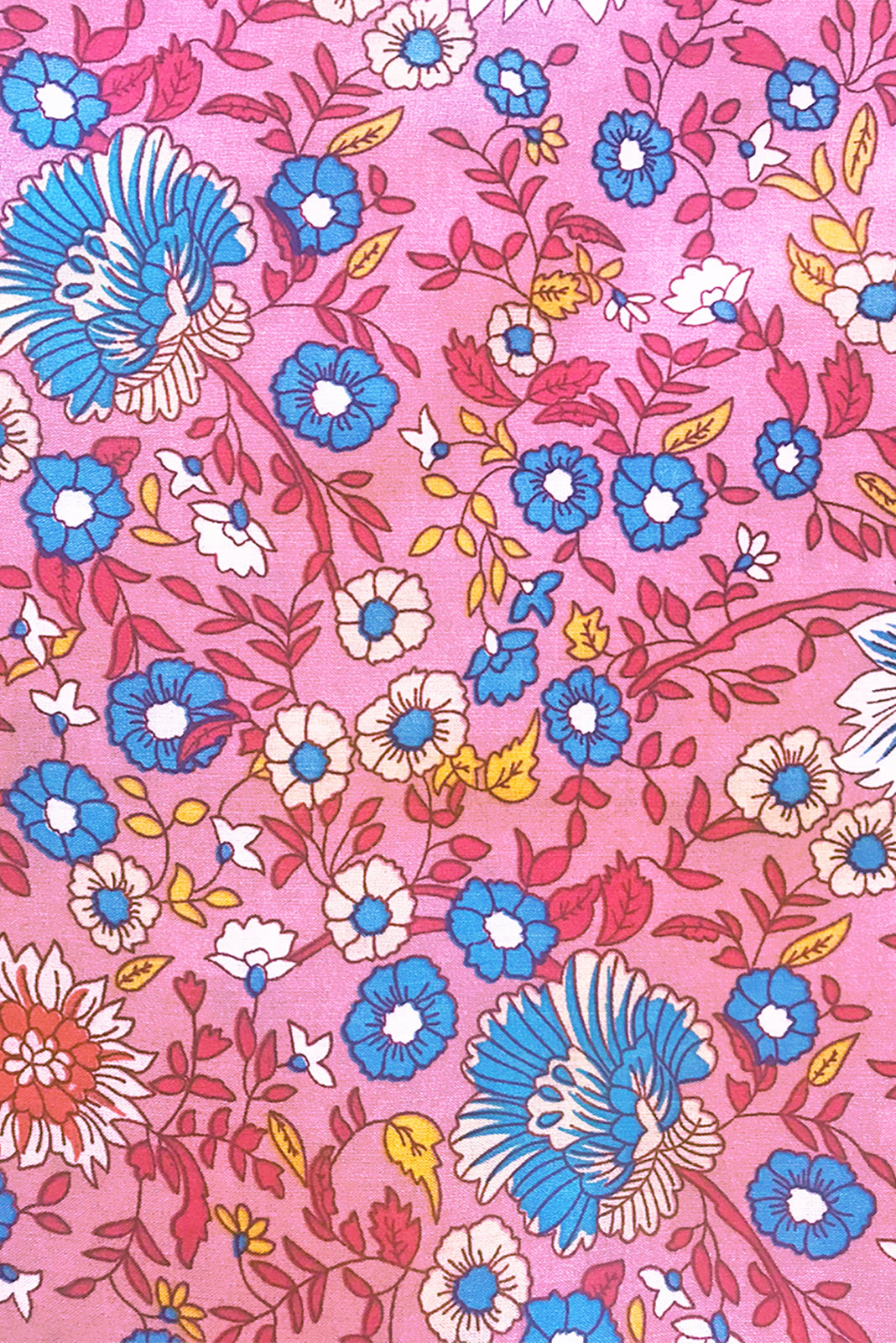 Fabric Swatch of Sapphire Raspberry Maxi Dress features soft pink base with raspberry, blue, white and yellow floral print in woven 100% rayon.