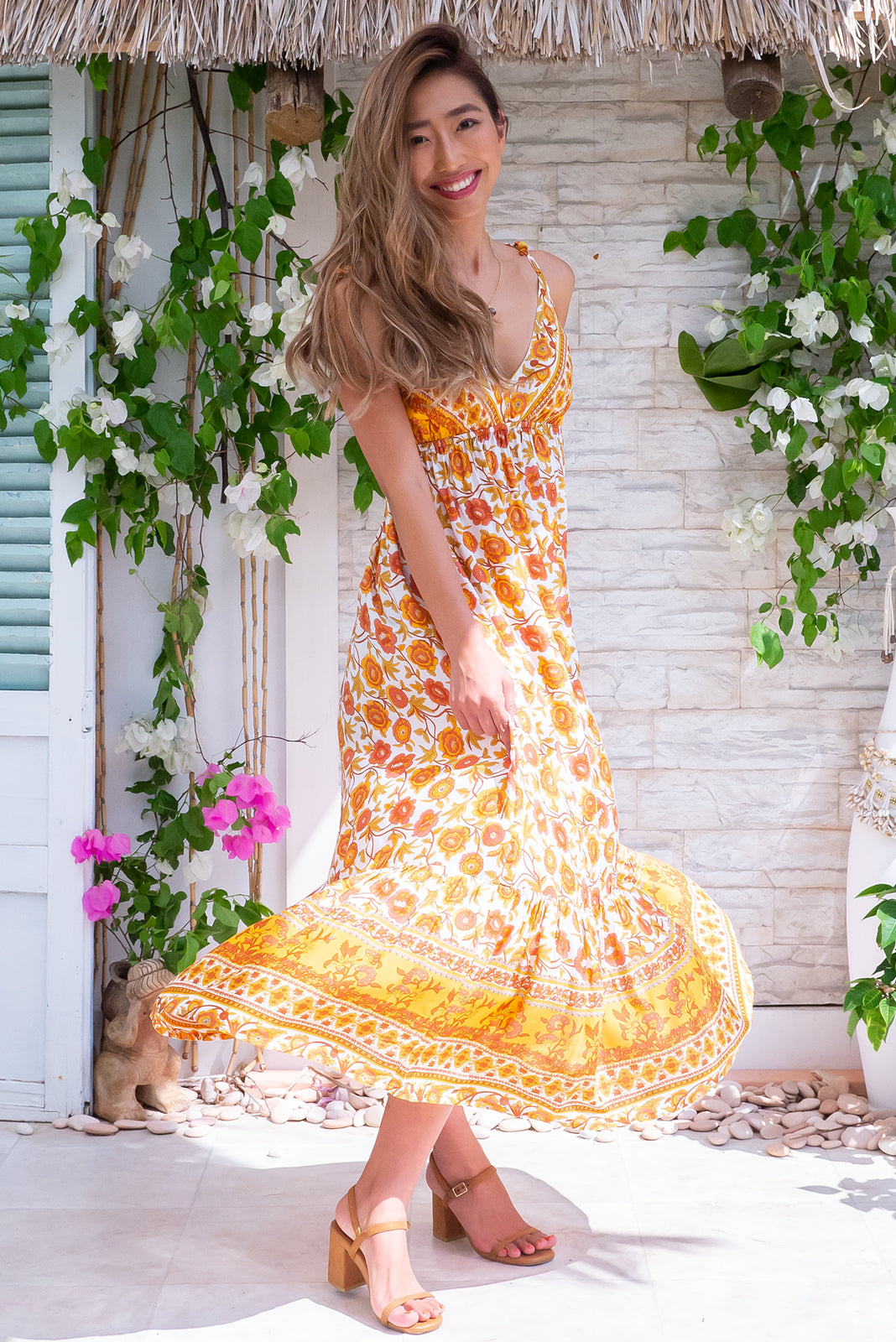 Sapphire Citrus Blooms Dress, true bohemian dream style features elasticated under bust, empire line, sleeveless with adjustable tie up straps, side pockets, white base with gold, mustard and terracotta floral print in woven 100% rayon.