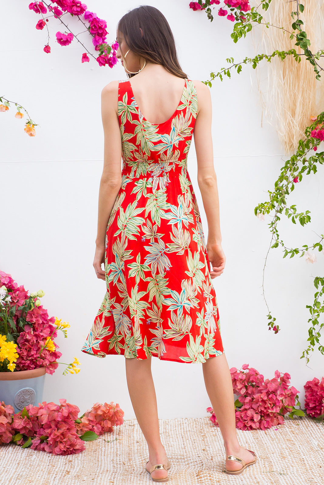 Sapphire Folio Red sleeves empire line sun dress with deep front pockets in a light weight woven rayon in a bright red, green and white jungle leaf print