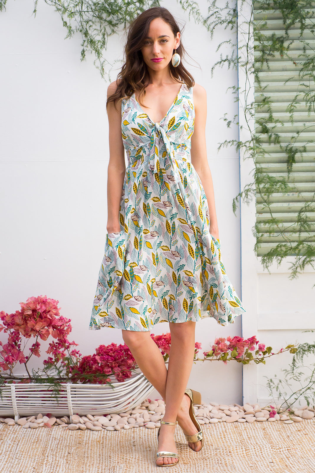 Sapphire Leafy Green sleeves empire line sun dress with white and green tropical leaf print front pockets in a light weight woven rayon