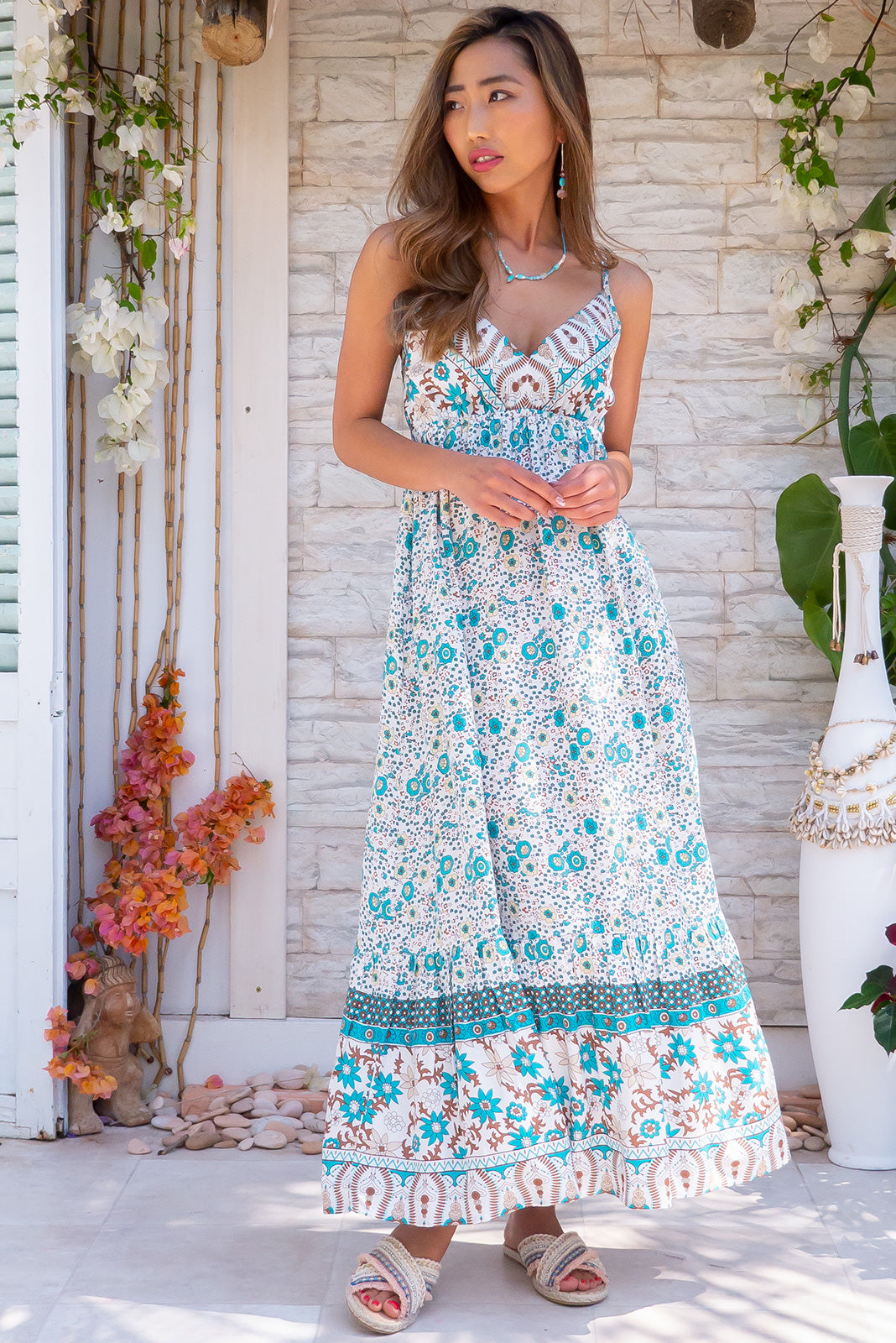 Sapphire Porto Teal Maxi Dress white floral printed dress in rayon fabric, with side pockets and adjustable straps.