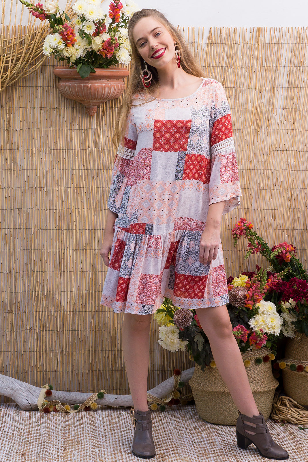 Savannah Desert Design drop waist dress features soft tonal boho inspired patchwork print on a crinkled woven rayon with a frill sleeve and beautiful decorative lace on the sleeve and across the front