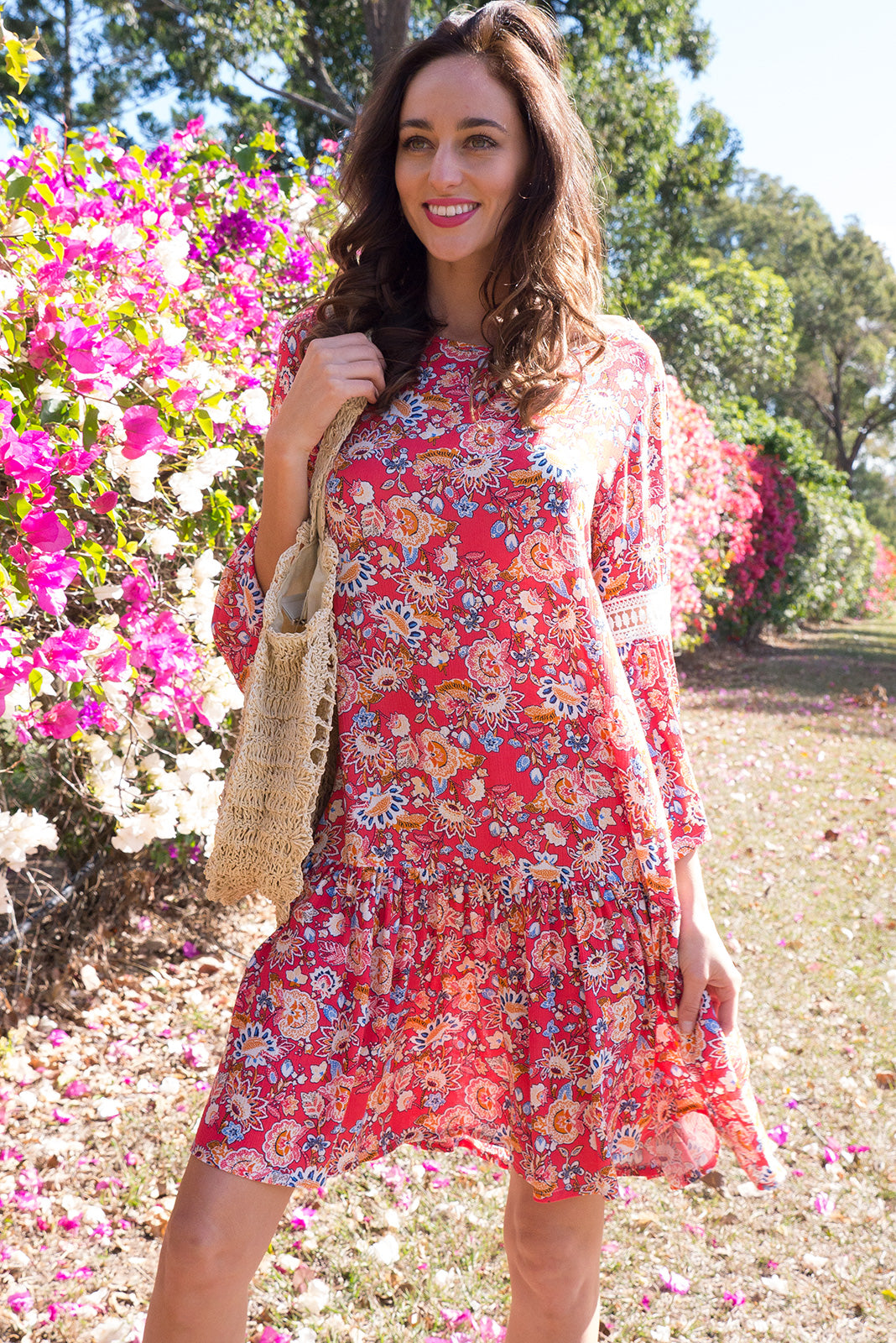 Savannah Melon Paisley Dress drop waist dress features a fun boho inspired paisley floral print on a crinkled woven rayon with a frill sleeve and beautiful decorative lace on the sleeve and across the front