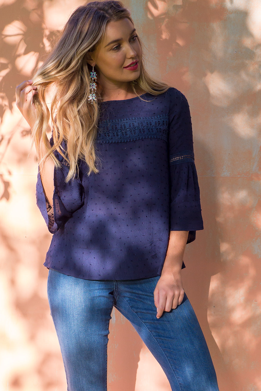 Savannah Top in Navy dobby woven rayon with a frill sleeve and beautiful decorative lace on the sleeve and across the front