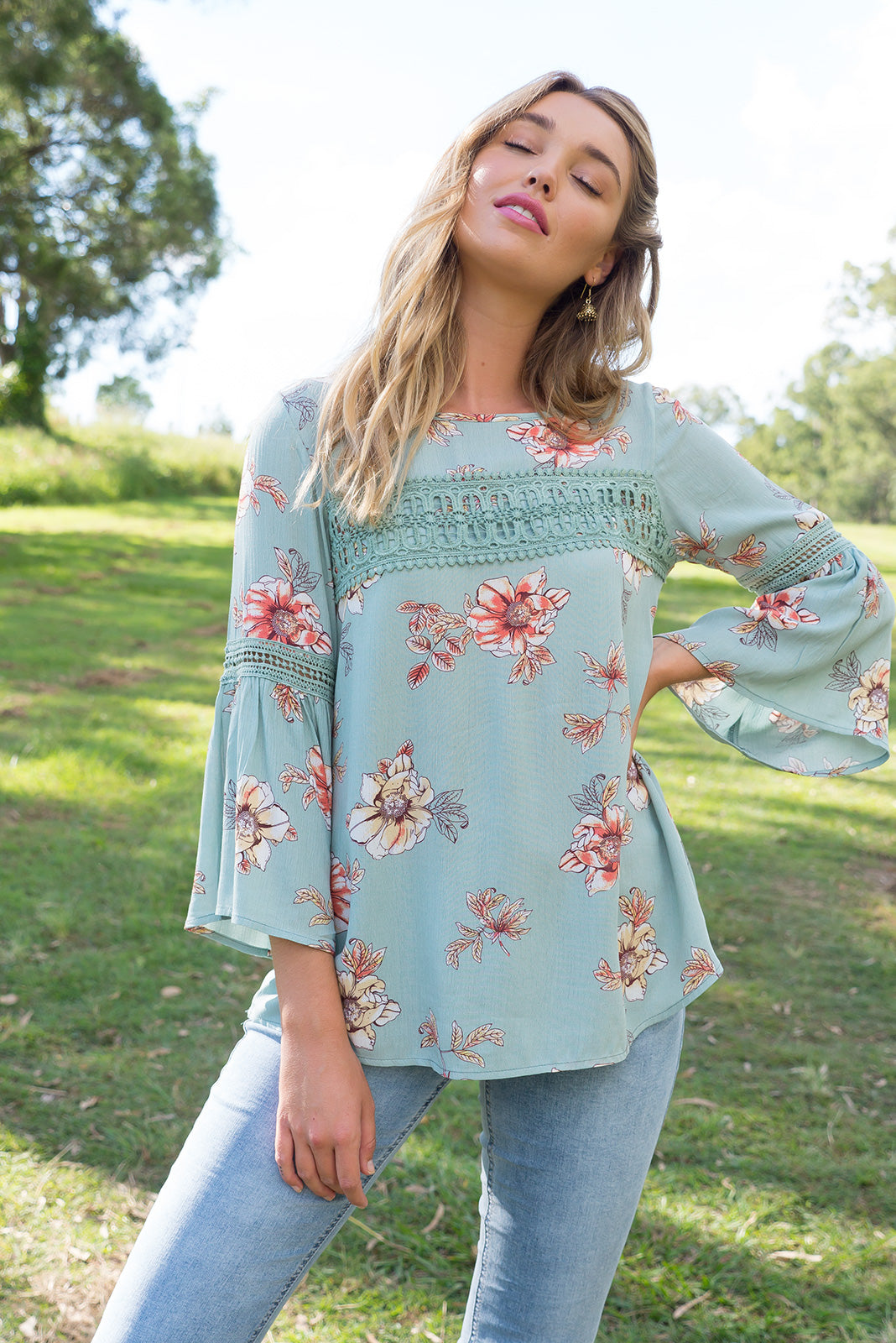 Savannah Top in Sage Green woven rayon with a floral print the top has a frill sleeve and beautiful decorative lace on the sleeve and across the front