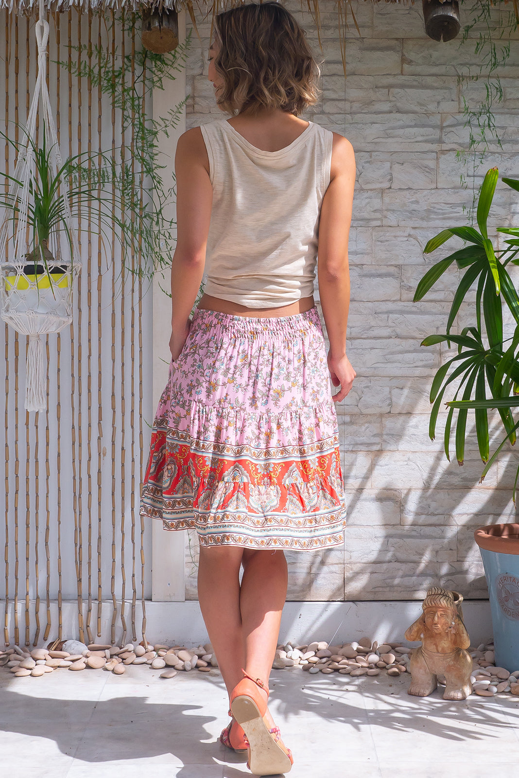 The Sea Coast Mini Skirt Strawberry Bohemian is such a comfortable pull-on style skirt featuring elasticated back waistband, tiered for flirty fullness, side pockets and 100% viscose in pale pink base with bohemian print and watermelon red border feature.
