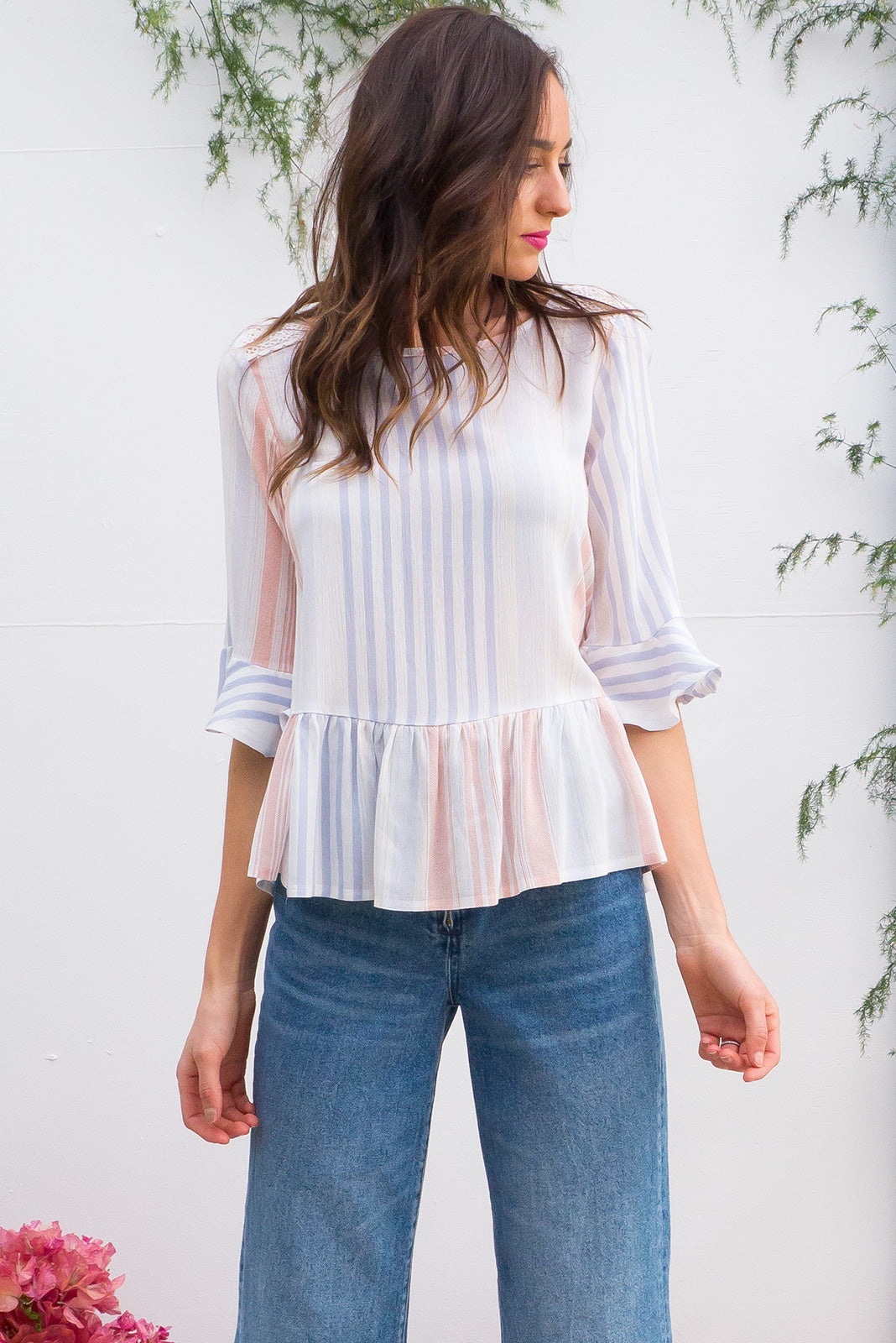 Sienna Arctic Stripe Top frill top has a soft drop waist and a bias cut frill sleeve cuff it comes in a crinkle textured rayon with a soft pastel stripe print