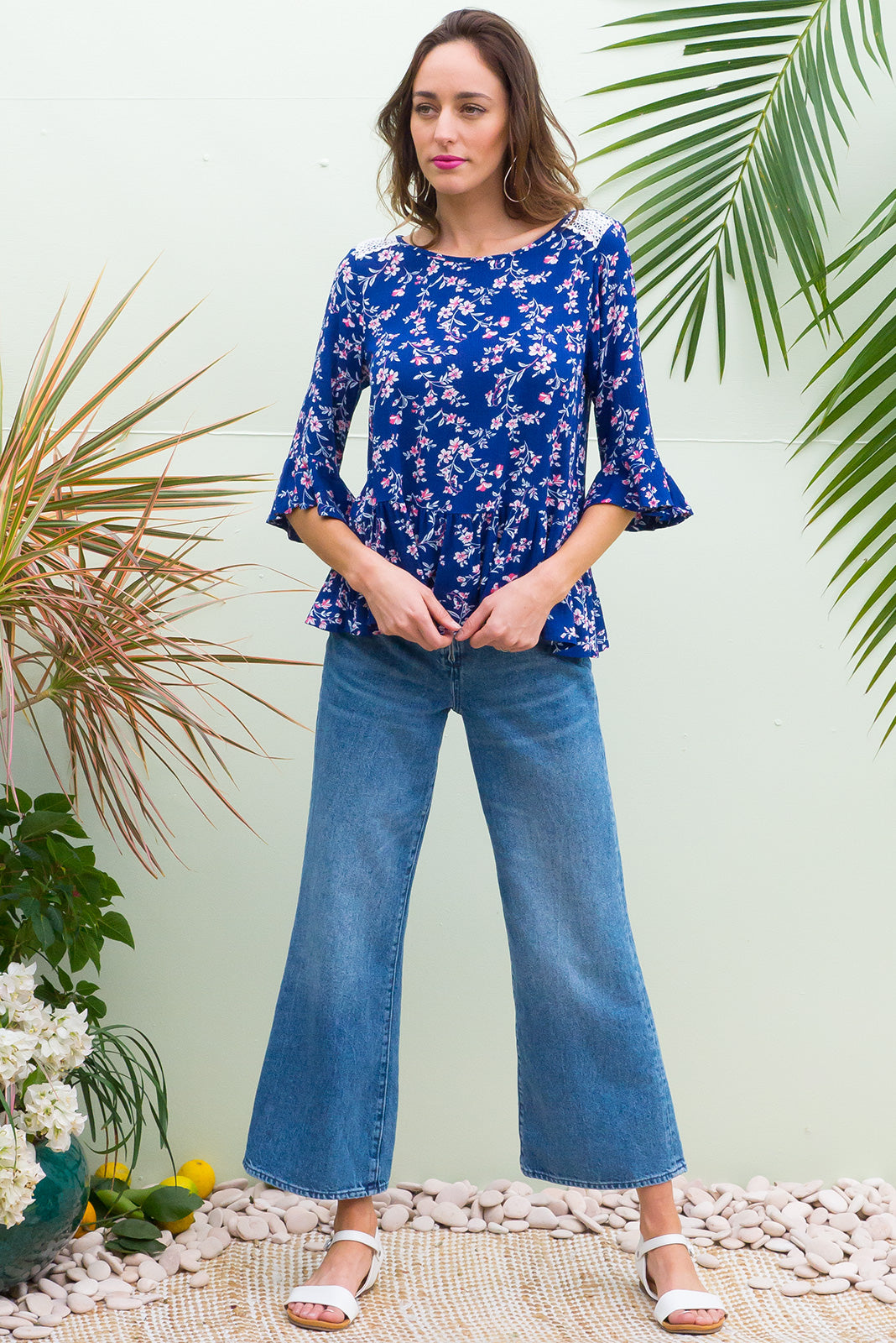 Sienna Tanna Blue Top frill top has a soft drop waist and a bias cut frill sleeve cuff it comes in a crinkle textured rayon with a bold and bright royal blue itzy floral print