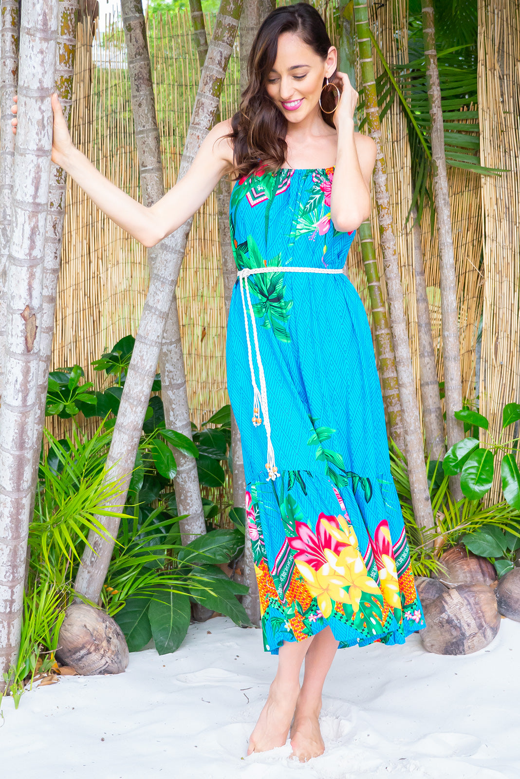 Soleil Beach Bahama Dress Maxi length rayon tiered dress with a adjustable neckline, side pockets in a stunning sky blue colour with a tropical island inspired border print