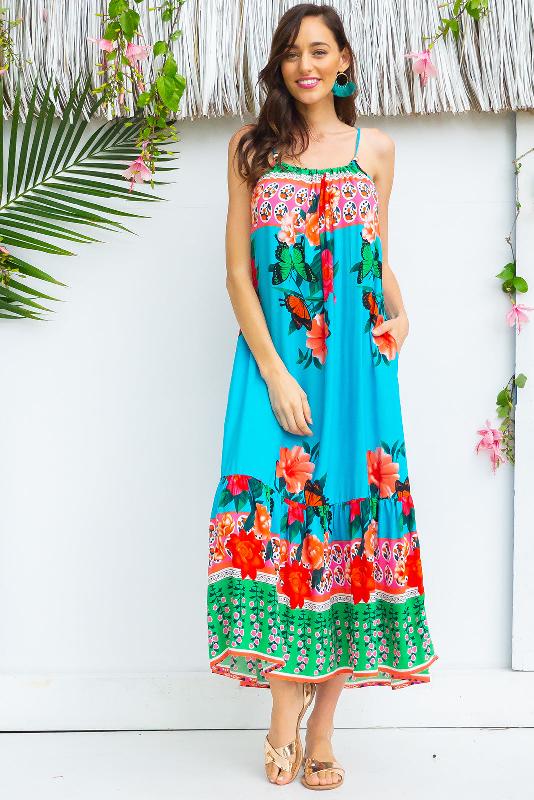 Soleil Rosetti Dress Maxi length rayon tiered dress with a adjustable neckline, side pockets in a stunning sky blue colour and roses inspired border print