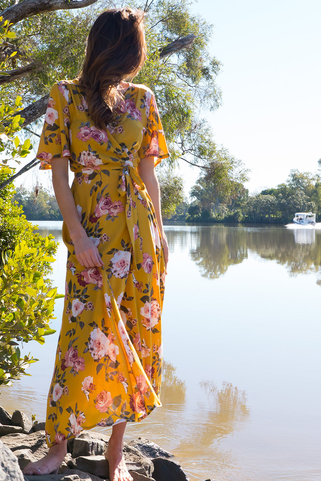 Spice Golden Canary Maxi Wrap Dress with a soft petal sleeve in a gorgeous golden yellow with a romantic rose print on a crinkle rayon