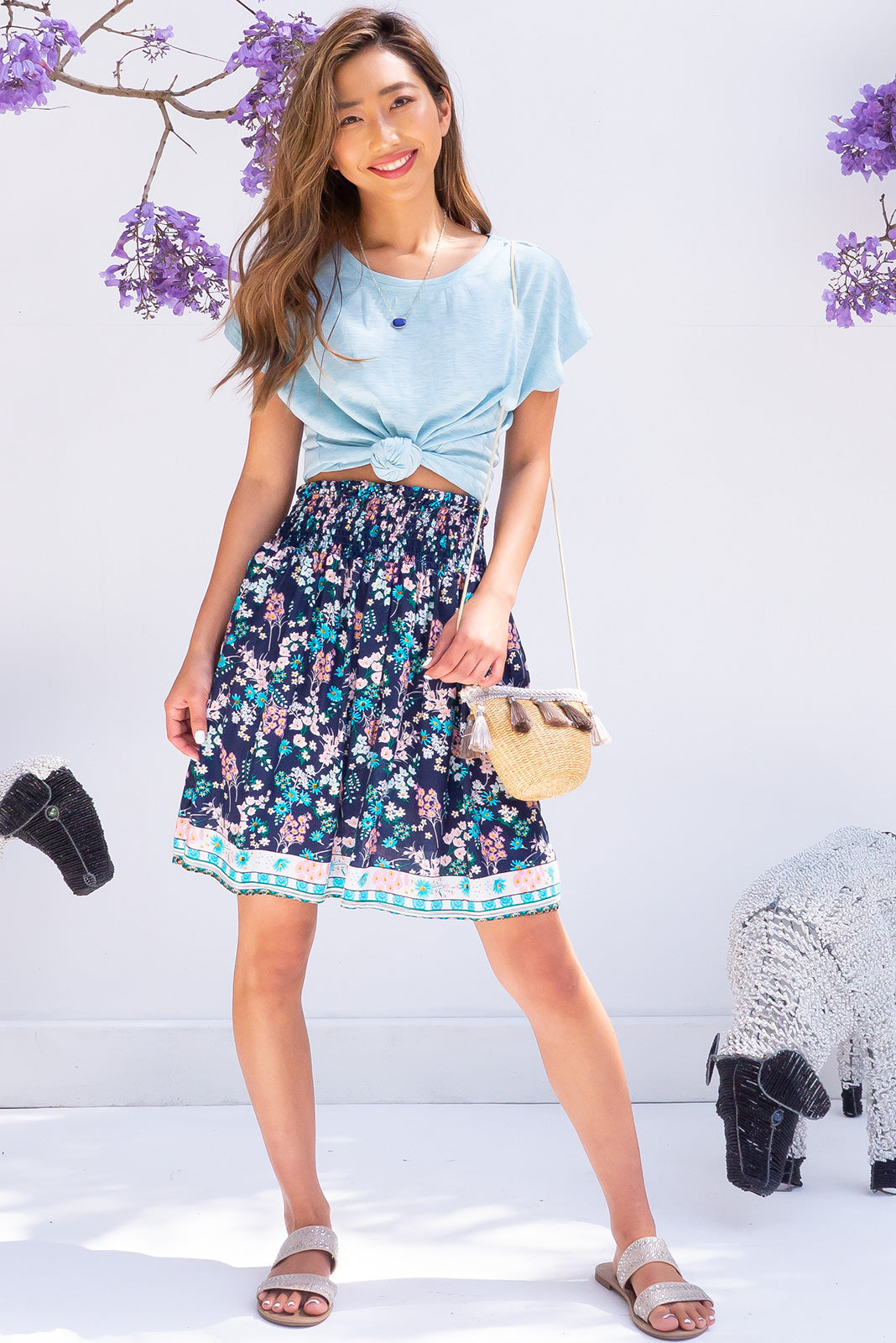 Spinel Wild Field Navy Skirt flirty short summer floral knee length skirt with side pockets, border print, shirred waist and made of rayon.