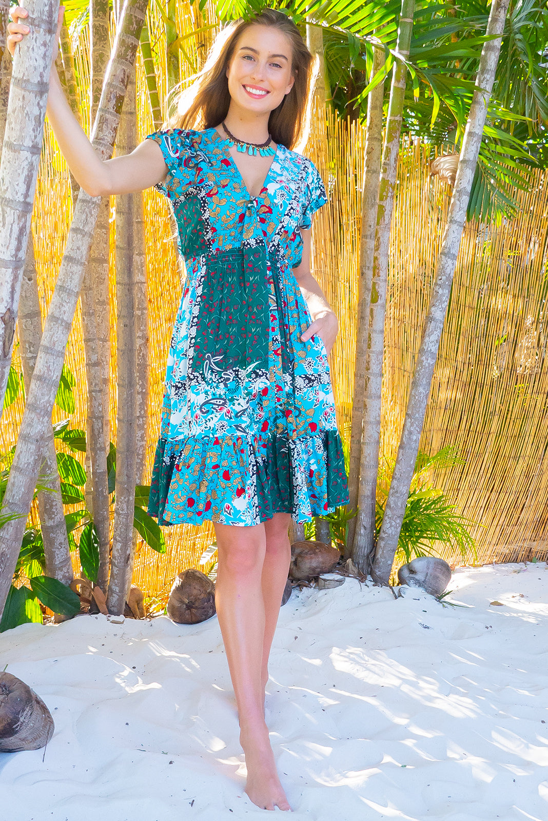 Stella Skies Patchwork Dress features elasticated empire line with a cap sleeve and deep v neck the fabric is a soft woven rayon in a bold and fun bohemian inspired patchwork print