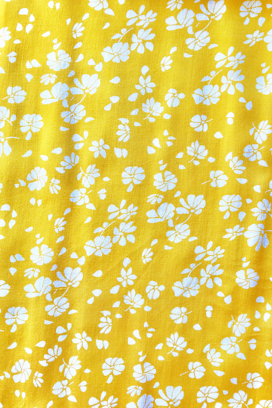 Fabric swatch, 100% woven rayon, bright yellow base with petite white floral print.