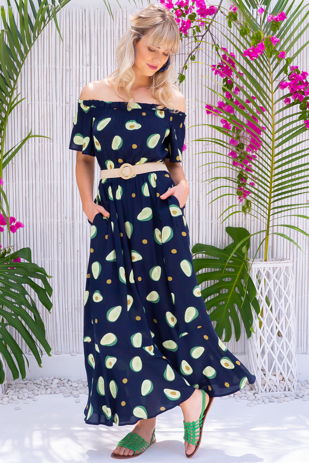 Surfmist Avocado Maxi Dress, bohemian summers style, 100% rayon, slight flare at hem, off the shoulder style, soft elastic ruching gently holds dress across shoulders, side pockets, elastic waist, deep navy base with a medium smiling avocado print.