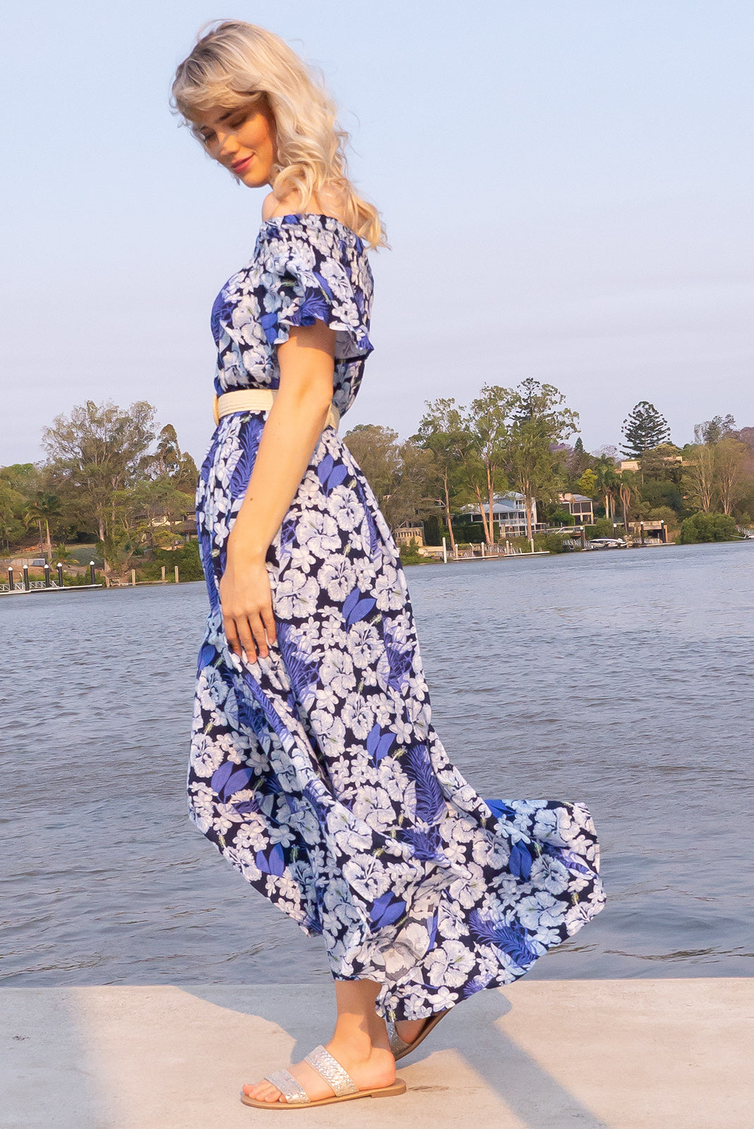 Surfmist Blue Island Maxi Dress, bohemian summer style, off the shoulder design, elastic waist, side pockets, deep navy base with a medium white floral design.