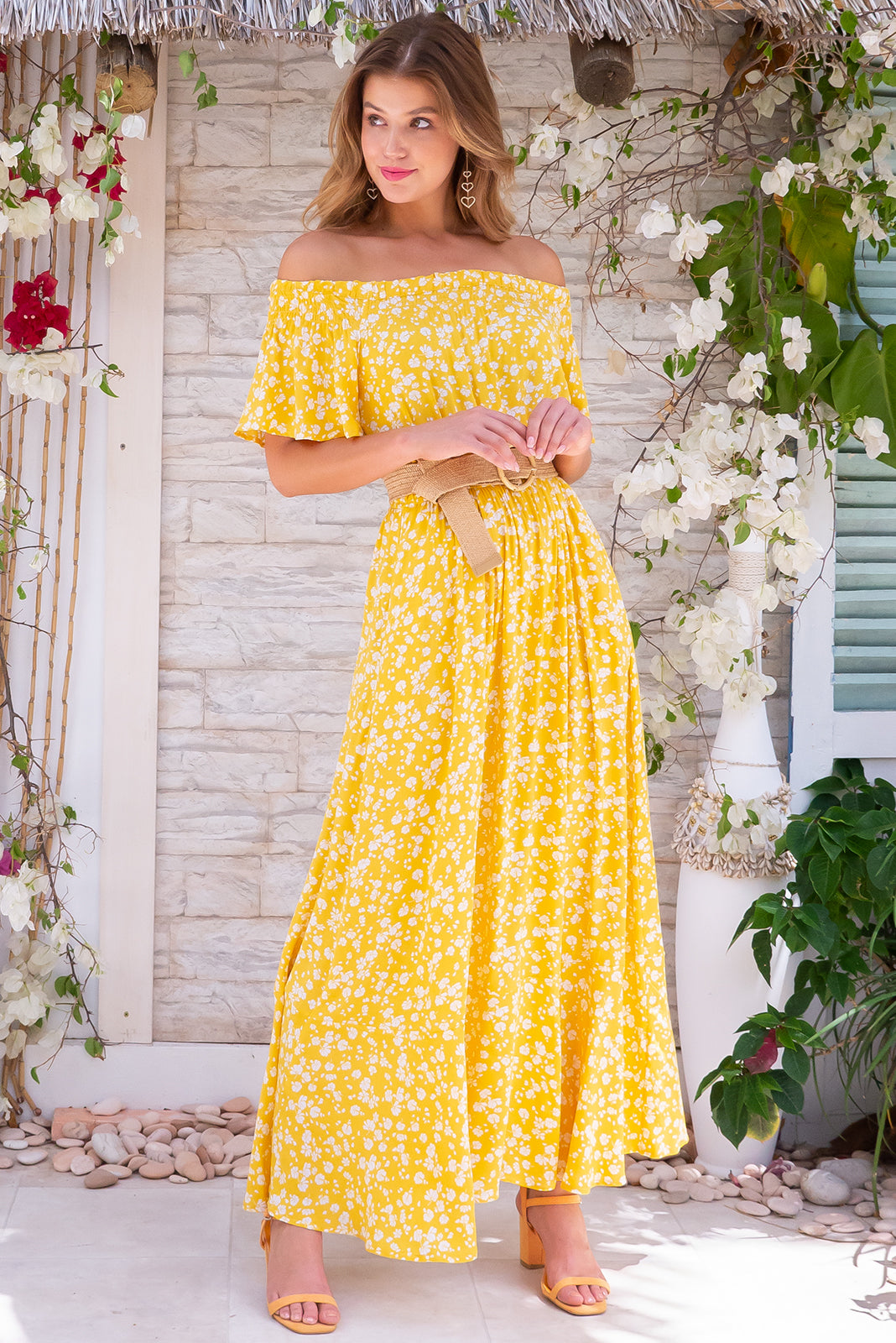 Surf Mist Sunshine Tipsy Maxi Dress, bohemian summer style, 100% rayon, slight flare at hem, soft elastic ruching gently holds dress across shoulders, side pockets, elastic waist, bright yellow base with small white floral print.