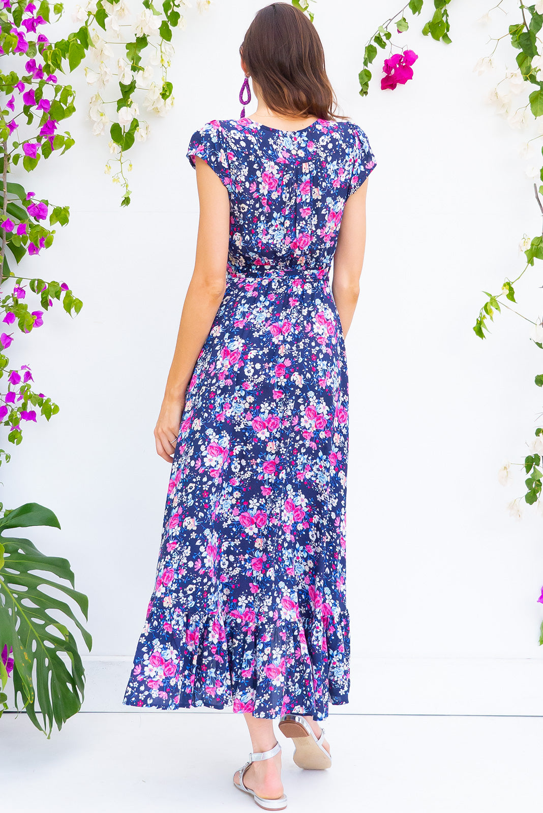 Symphony Blue Curacao Maxi Wrap Dress with a fitted bodice, cap sleeve and frill around the hem in a bright lapis blue floral print on soft rayon