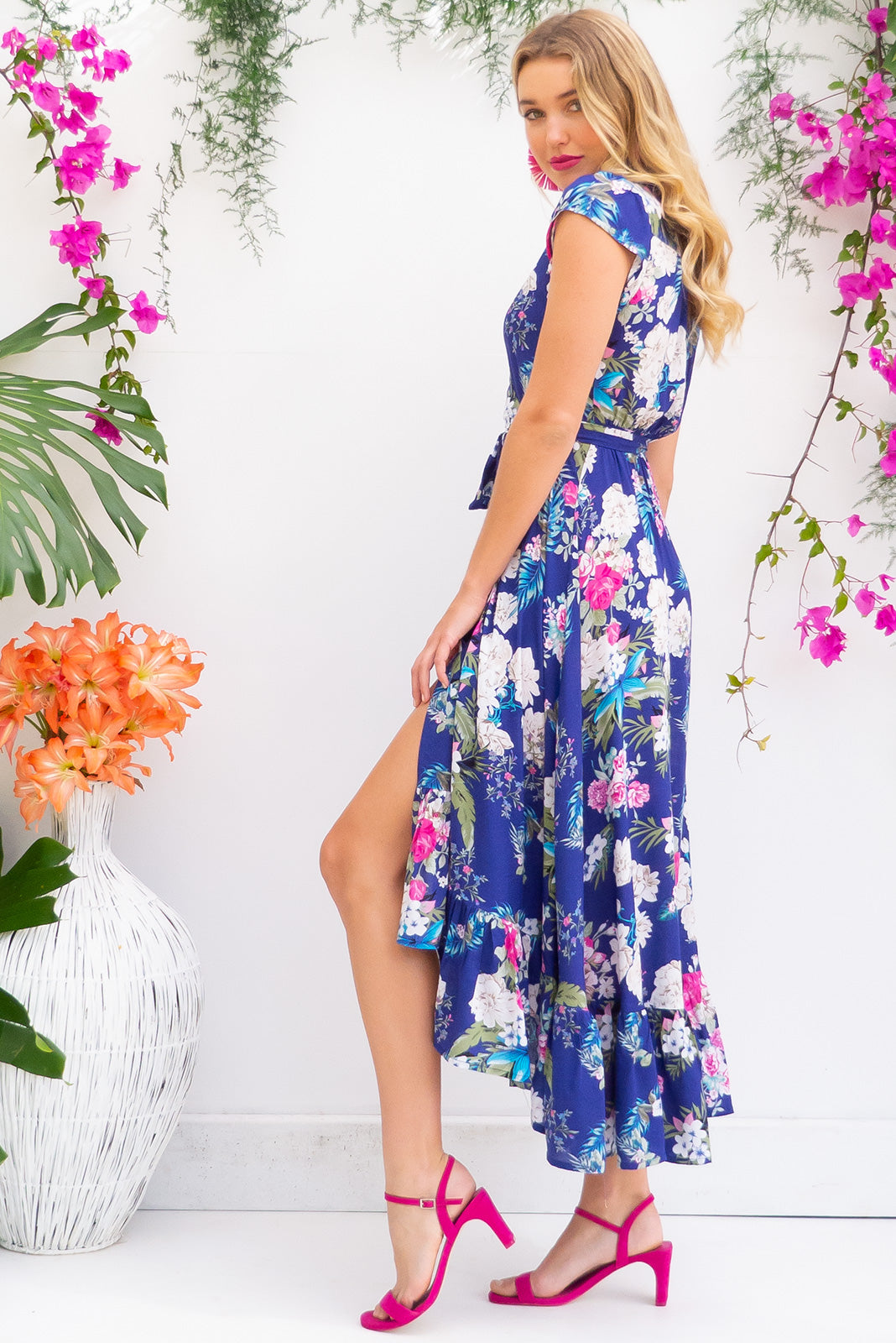 Symphony Del Mar Blue Maxi Wrap Dress with a fitted bodice, cap sleeve and frill around the hem in a bright lapis blue floral print on soft rayon