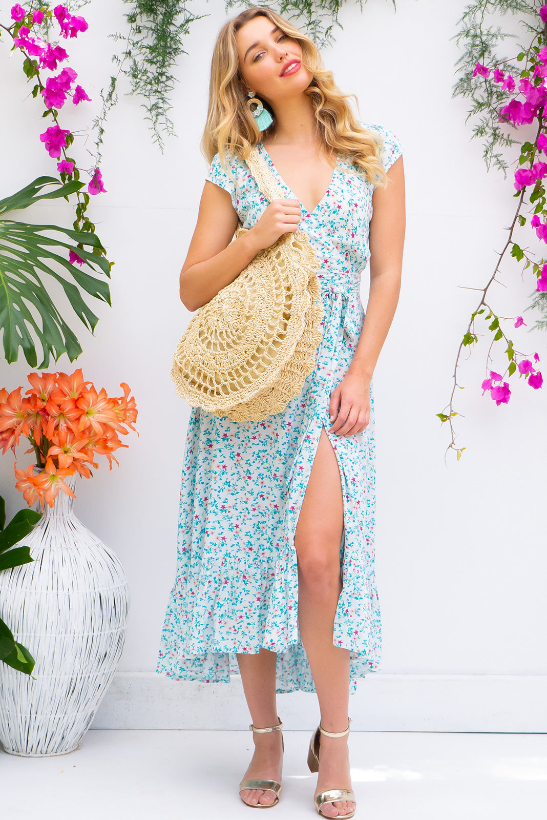 Symphony Ice Cream Maxi Wrap Dress with a fitted bodice, cap sleeve and frill around the hem in a bright white and blue ditzy floral print on soft rayon