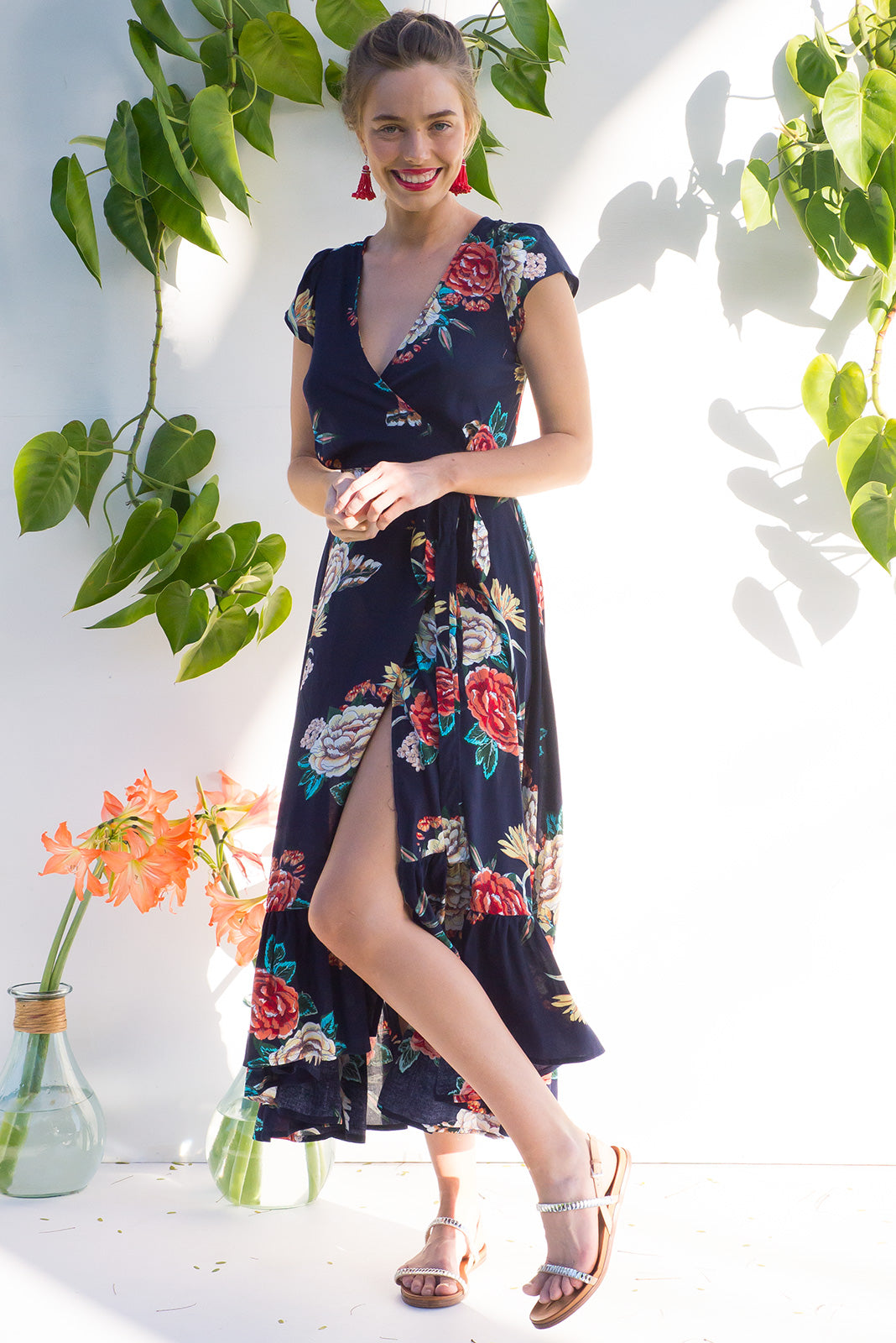 Symphony Maxi Wrap Dress with a fitted bodice, cap sleeve and frill around the hem in a stunning deep navy and red romantic floral print