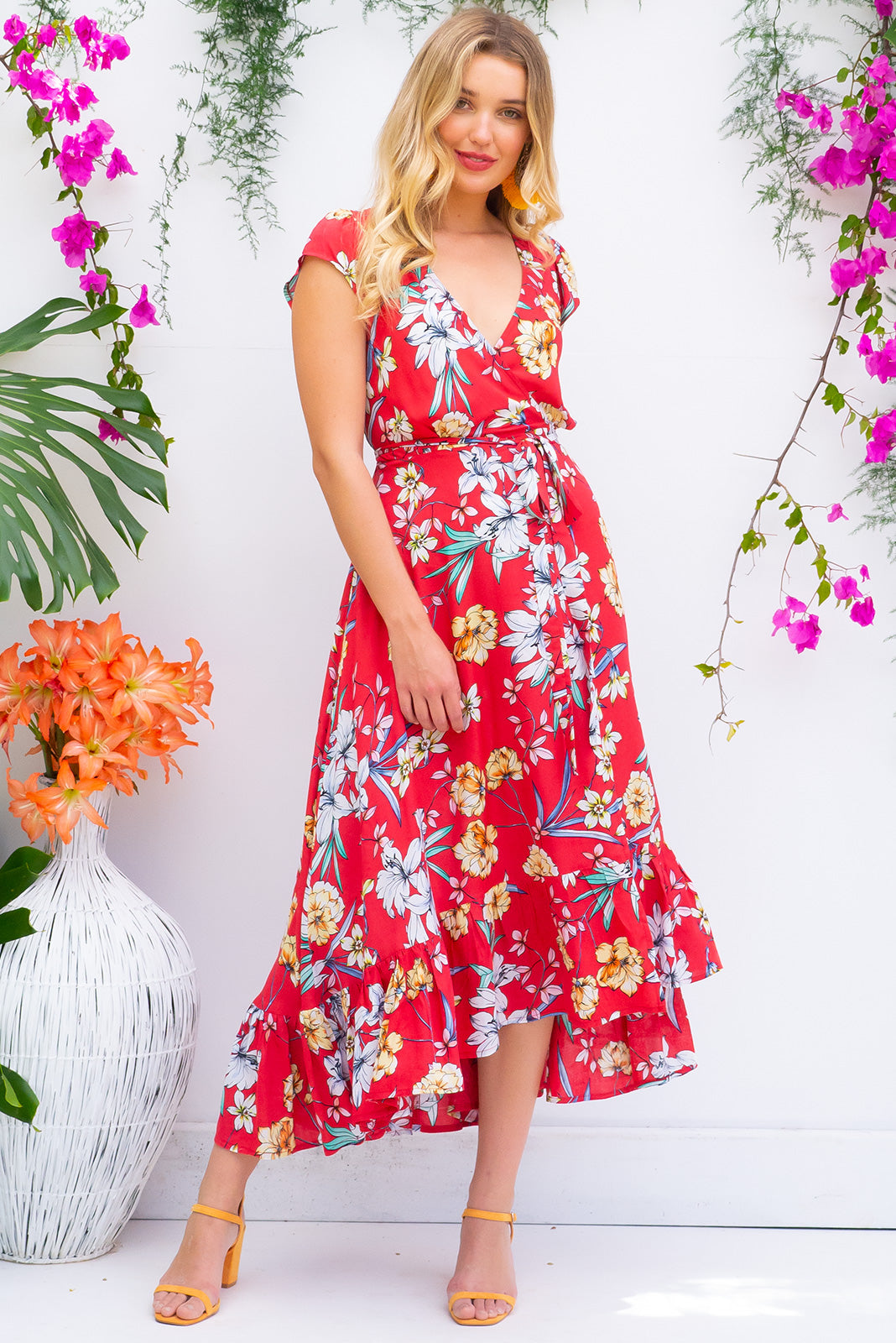 Symphony Summer Red Maxi Wrap Dress with a fitted bodice, cap sleeve and frill around the hem in a bright red floral print on soft rayon