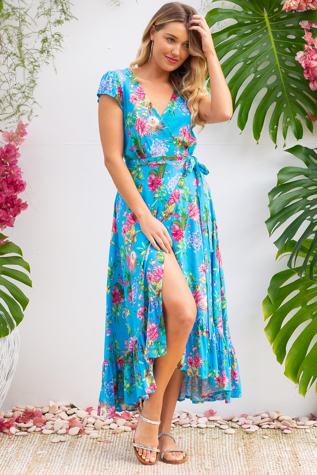 Symphony Verdi Sky Maxi Wrap Dress with a fitted bodice, cap sleeve and frill around the hem in a bright sky blue floral print on rayon