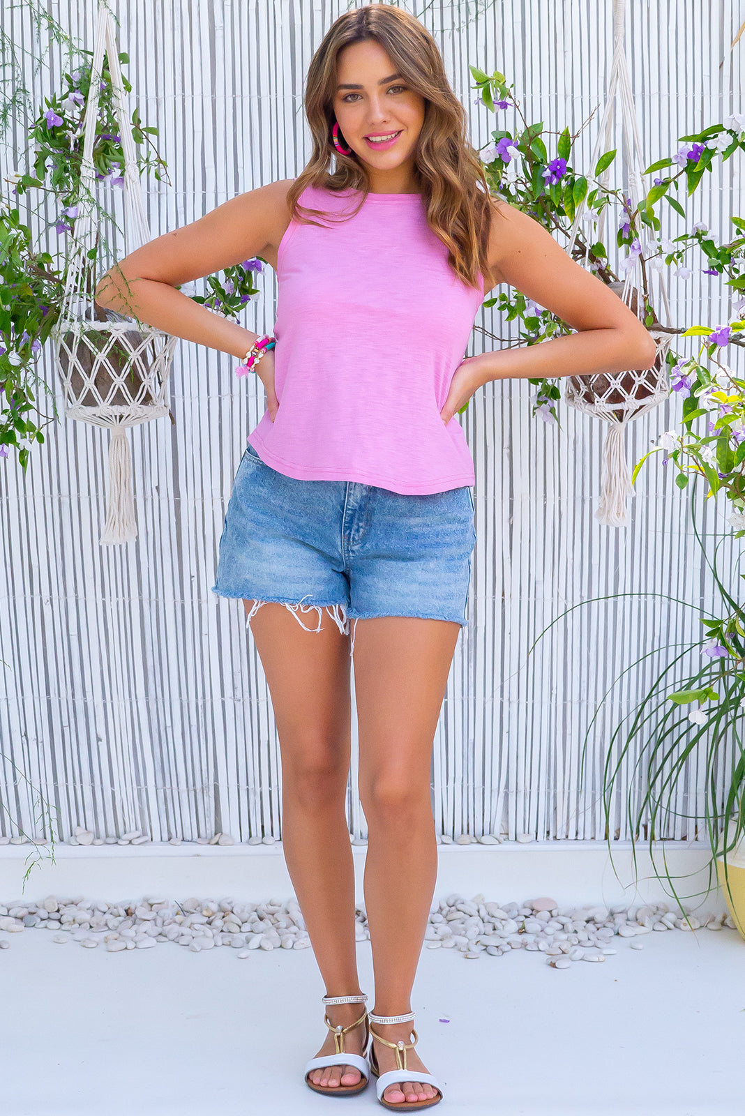 The Tali Pink Sugar Tank Top is a classic tank top cut featuring narrow over bust, relaxed around middle, sleeveless and 55% cotton, 45% polyester in sweet taffy pink colour.